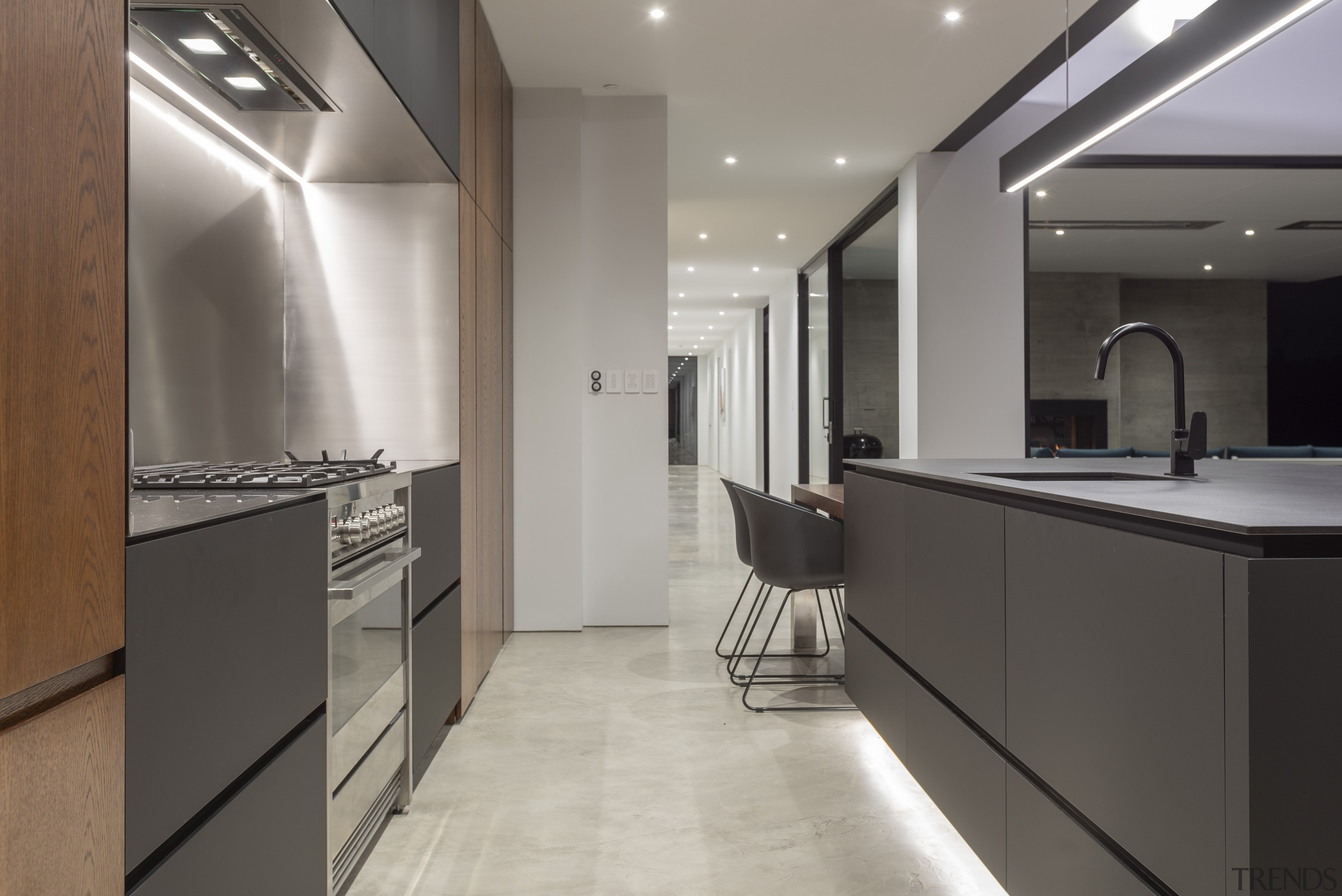 ​​​​​​​Slimline Dekton benchtops with a negative detail, together architecture, lighting, kitchen, pendant, cabinetry, countertop, floor, flooring, furniture, interior design, kitchen, Dekton, Cube Dentro,