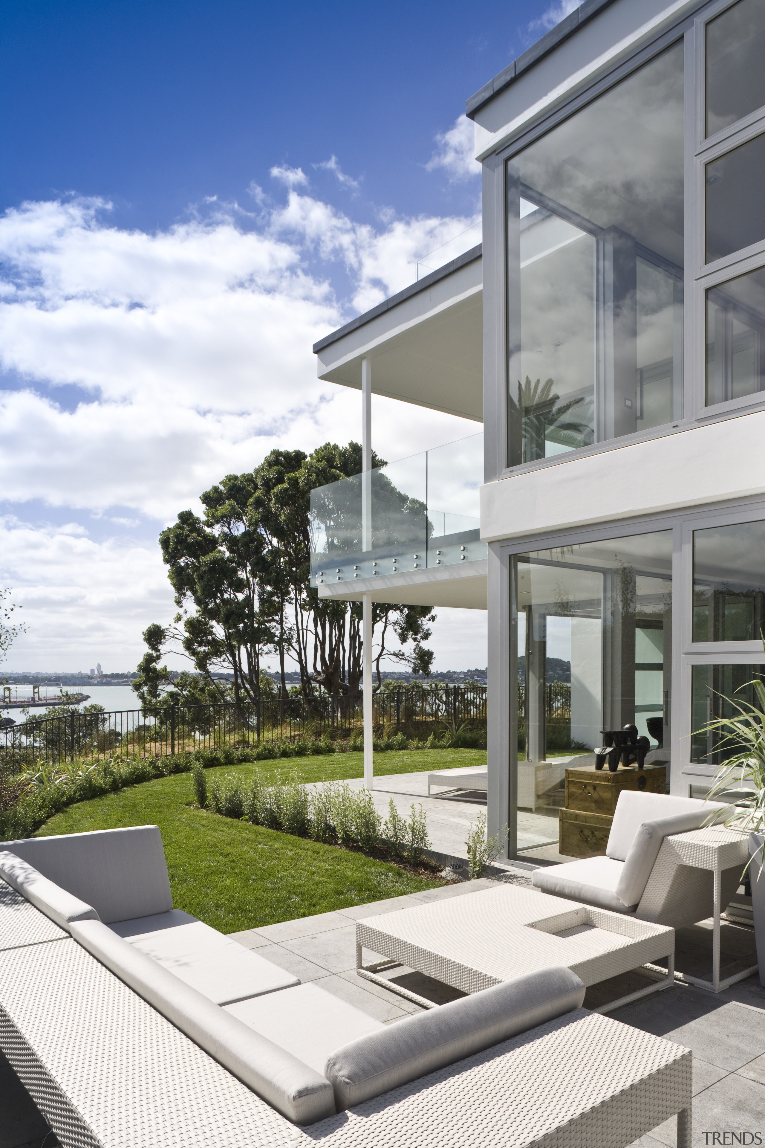 Exterior view of a Parnell apartment complex which apartment, architecture, condominium, daylighting, estate, home, house, mixed use, outdoor furniture, property, real estate, residential area, sunlounger, window, white, gray