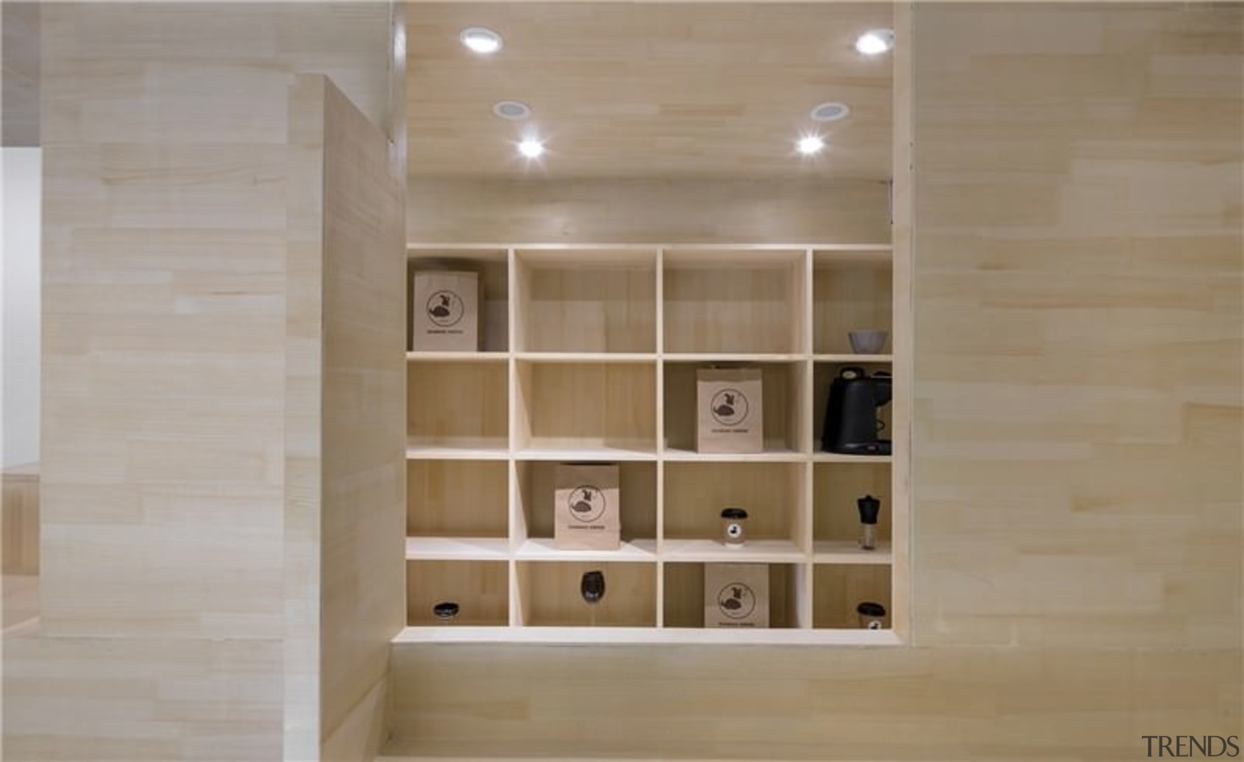 The wood creates a soft space - The bookcase, cabinetry, floor, flooring, furniture, hardwood, interior design, plywood, shelf, shelving, tile, wall, wood, wood flooring, gray, brown