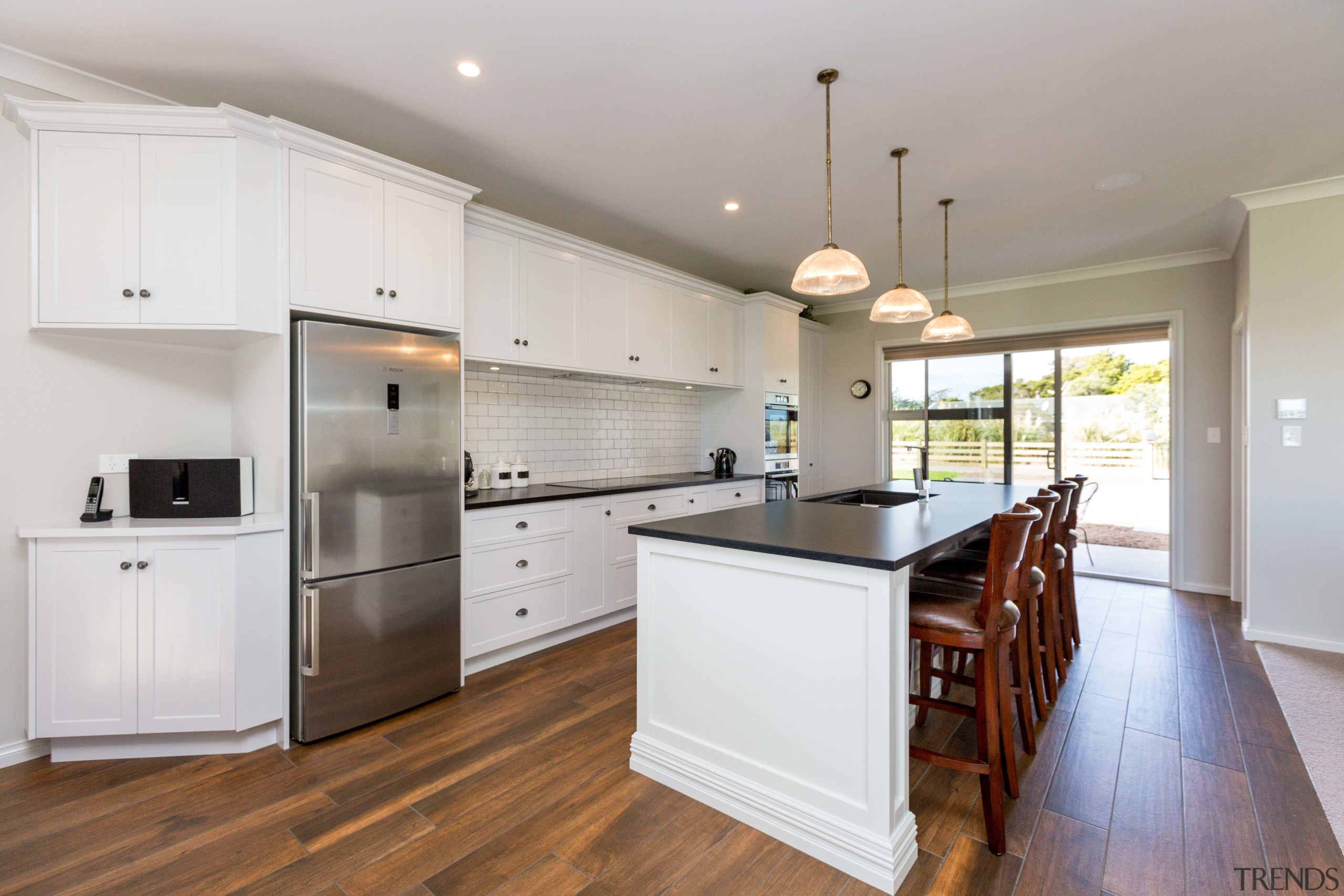 Moulded cabinetry sits above ceramic tiled plank flooring cabinetry, countertop, cuisine classique, floor, flooring, hardwood, interior design, kitchen, laminate flooring, property, real estate, room, wood flooring, gray