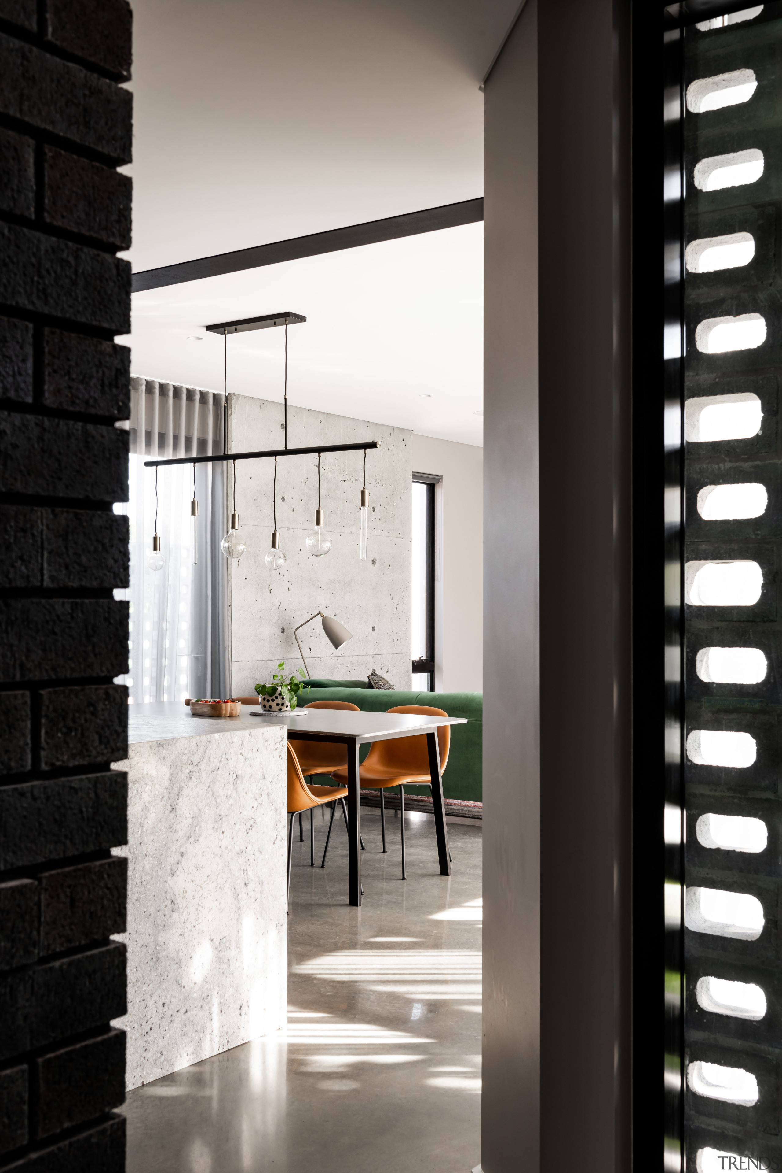 A feature wall in cast-in-situ poured concrete in architecture, floor, flooring, furniture, house, interior design, lighting, tile, wall, black, white, kitchen,  Dalecki Design