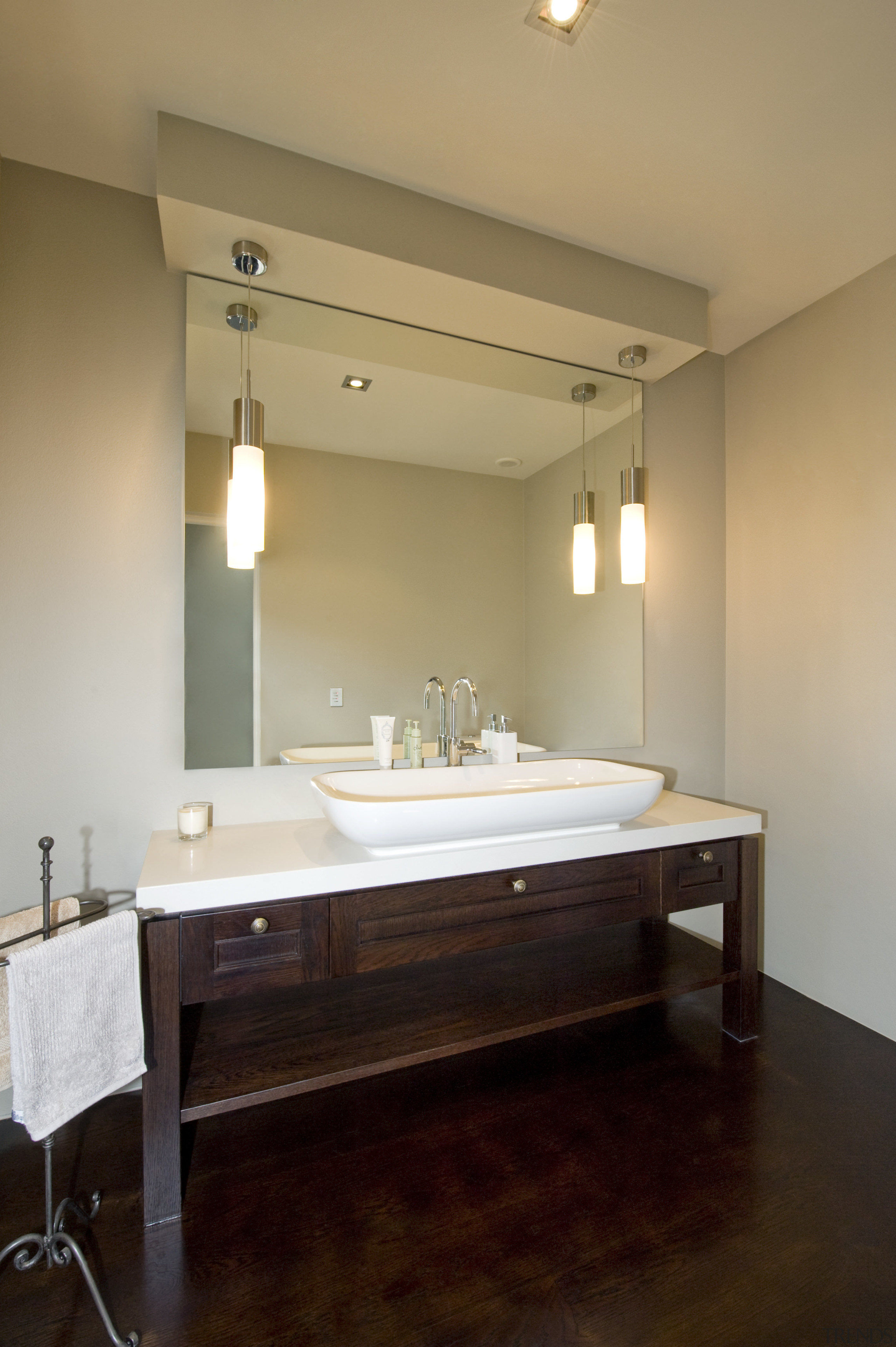 Image of the bathroom which the vanities have bathroom, ceiling, floor, flooring, interior design, lighting, room, sink, orange, black