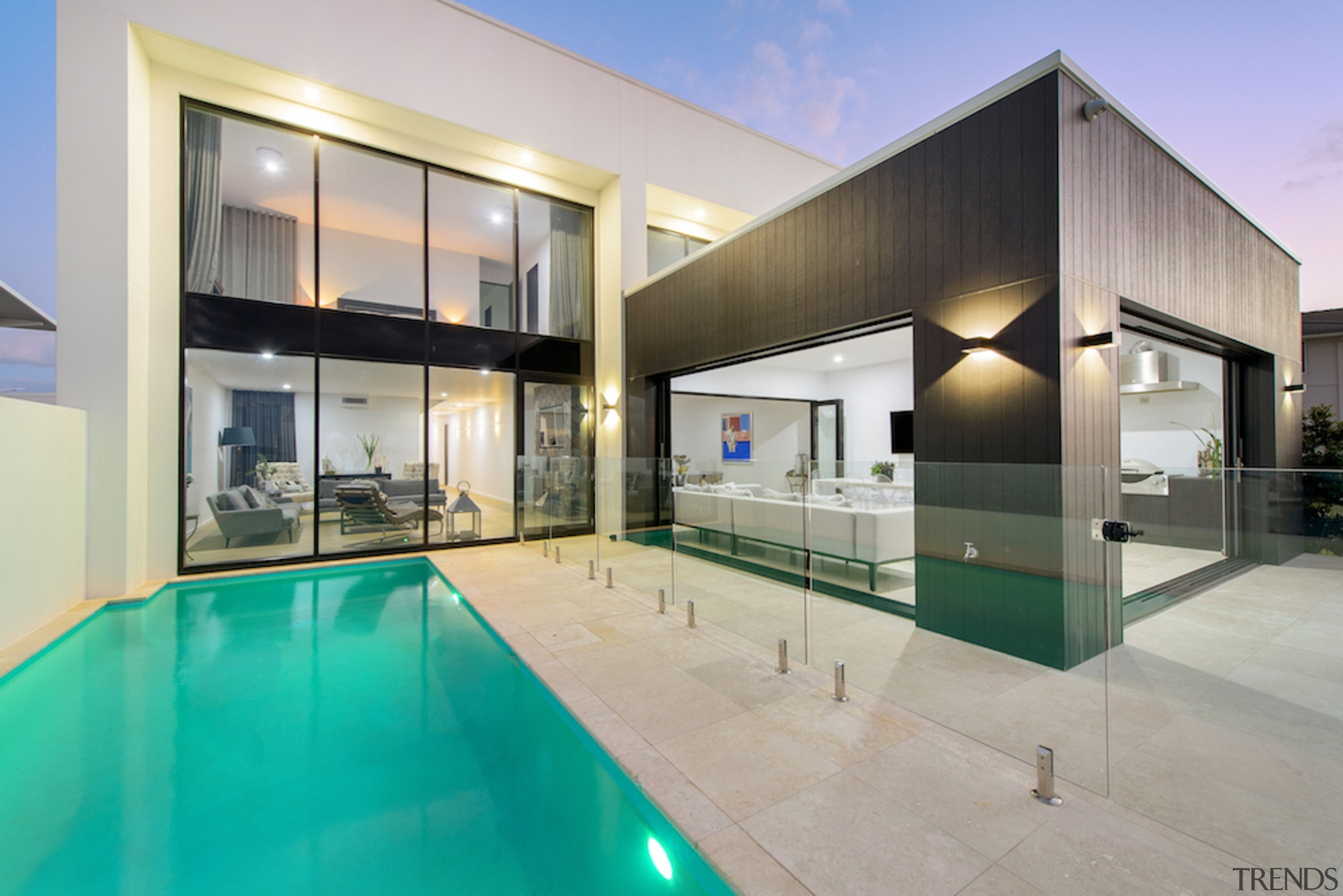 Glass balustrading optimises the home's stunning outlooks. The apartment, architecture, building, ceiling, design, estate, facade, glass, home, house, interior design, property, real estate, residential area, room, swimming pool, villa, gray