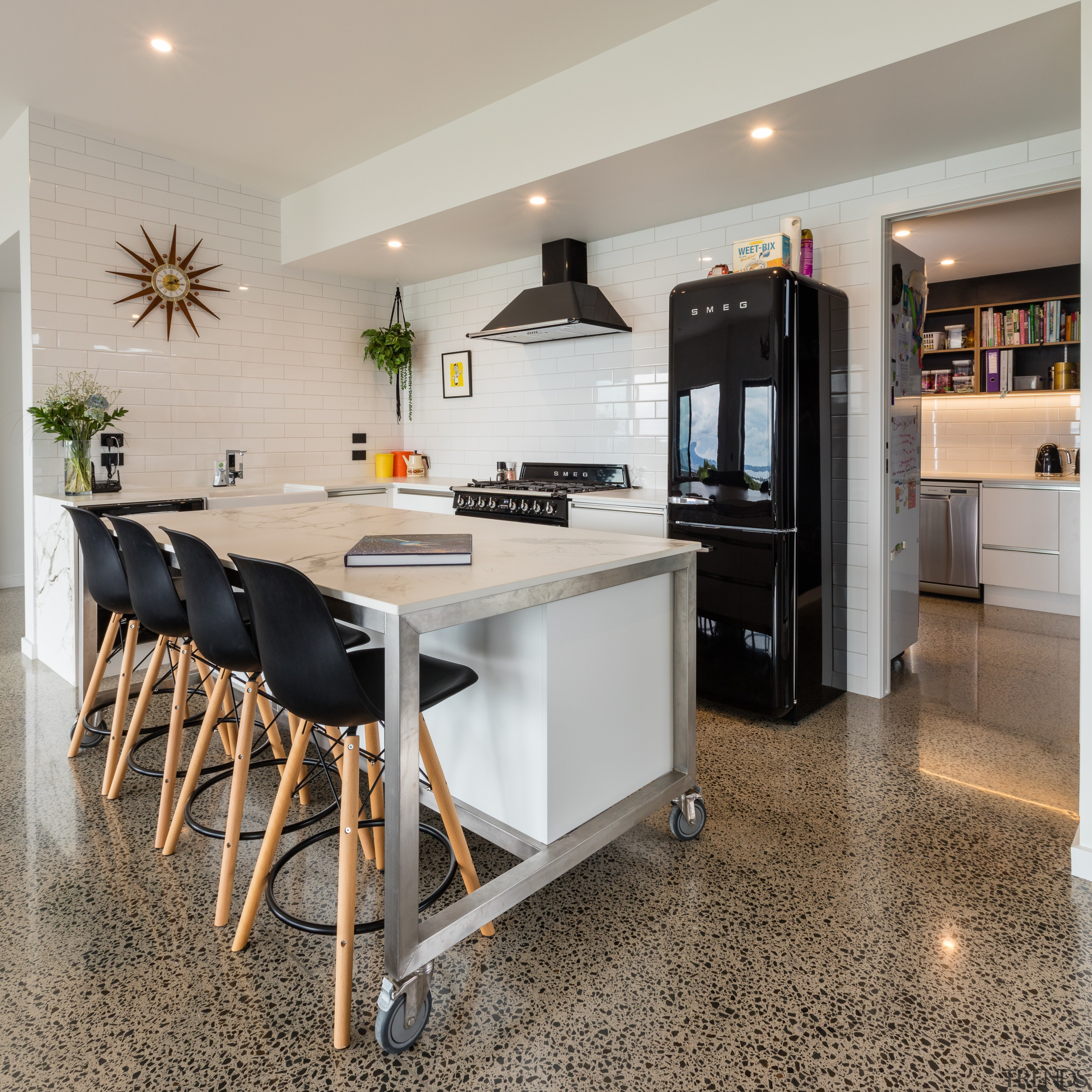 Meals on wheels  with the castors unlocked, countertop, floor, flooring, furniture, interior design, kitchen, table, gray