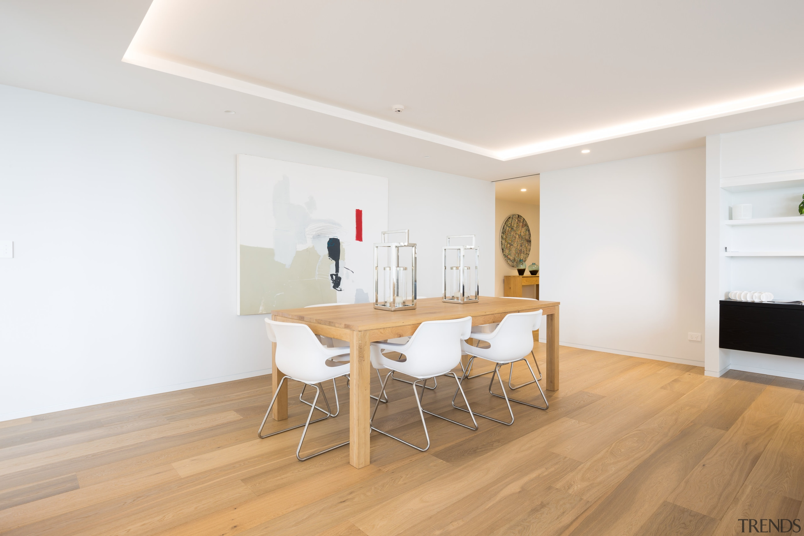 On this development, the apartments serene interiors are apartment, ceiling, floor, flooring, furniture, hardwood, house, interior design, laminate flooring, property, real estate, room, table, wood, wood flooring, white