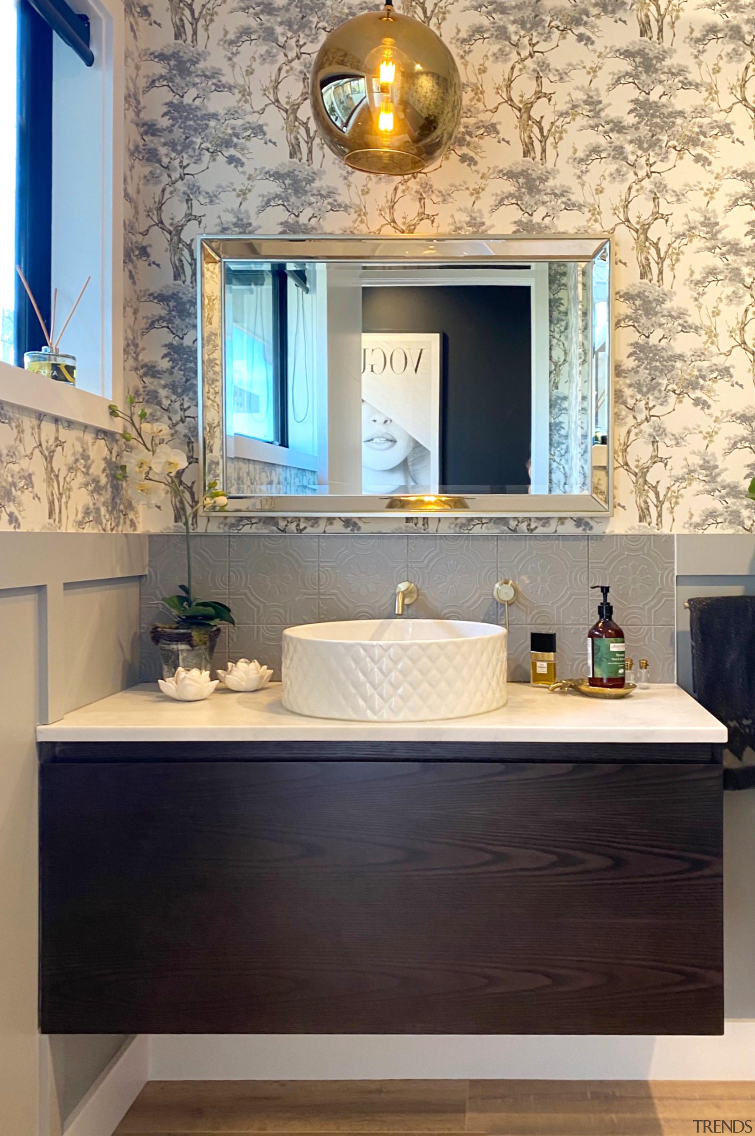 This generous powder room was designed to make