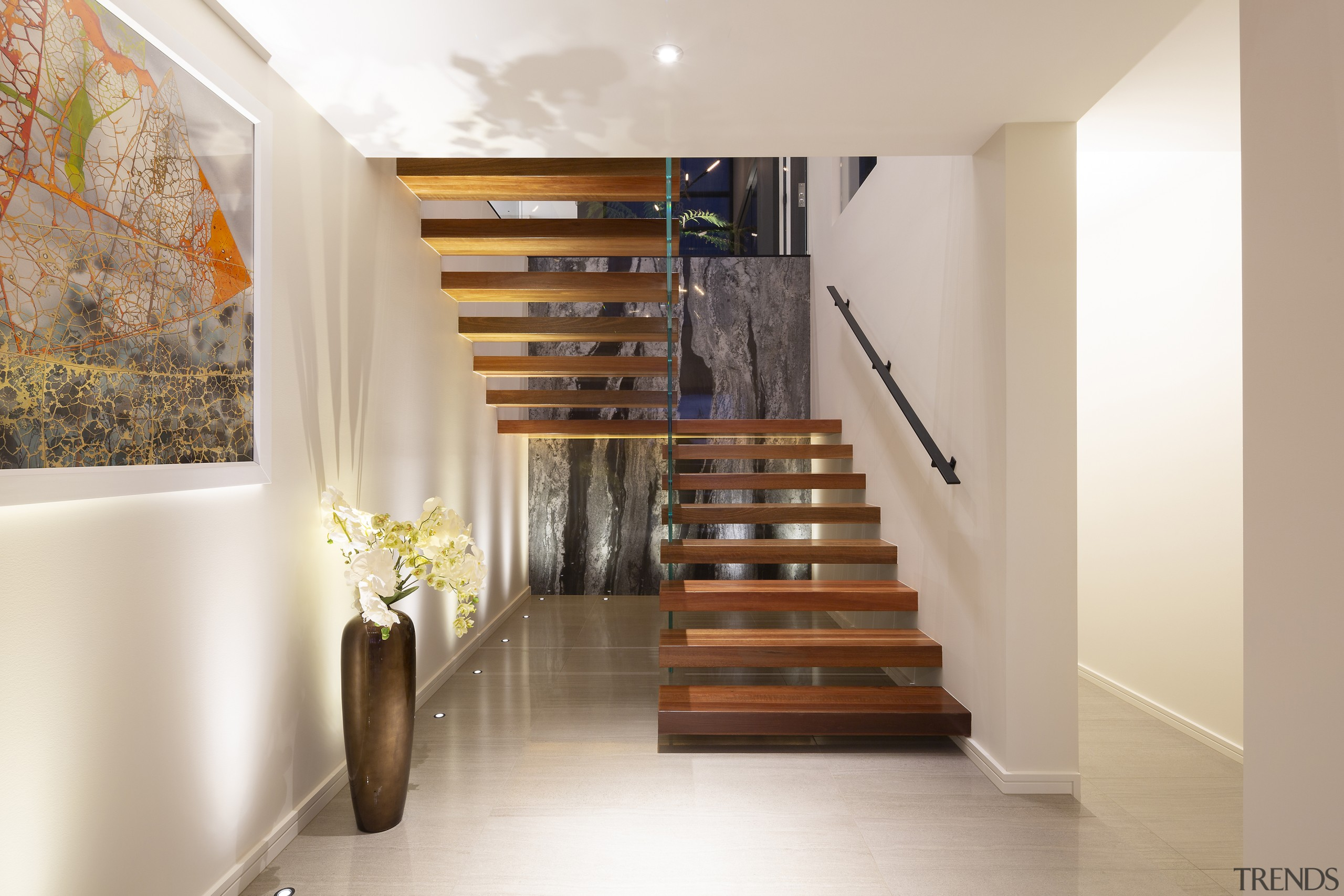The open timber stairs at front entry. -