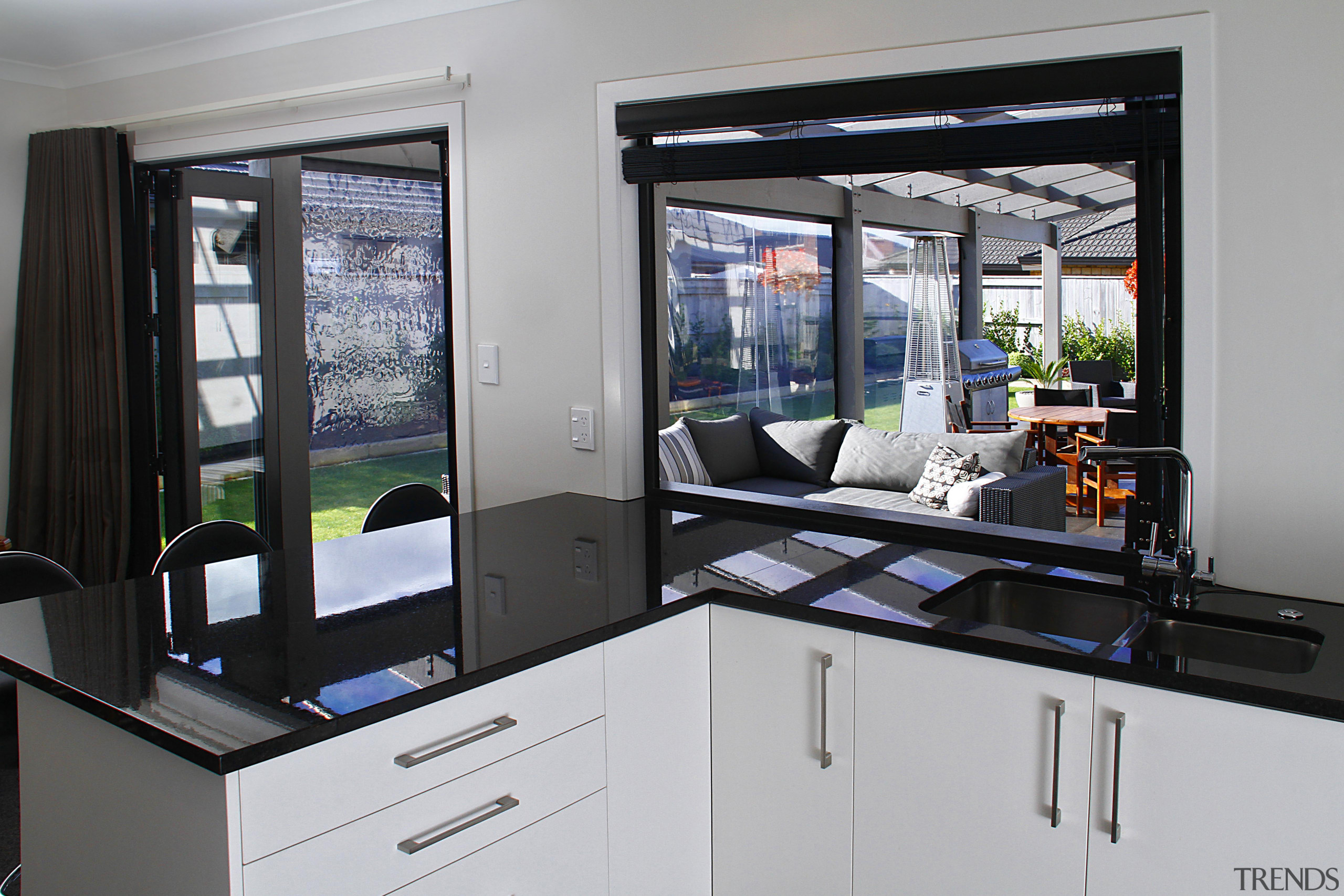 In this house by Fowler Homes Manawatu landscaped home appliance, kitchen, window, gray, black
