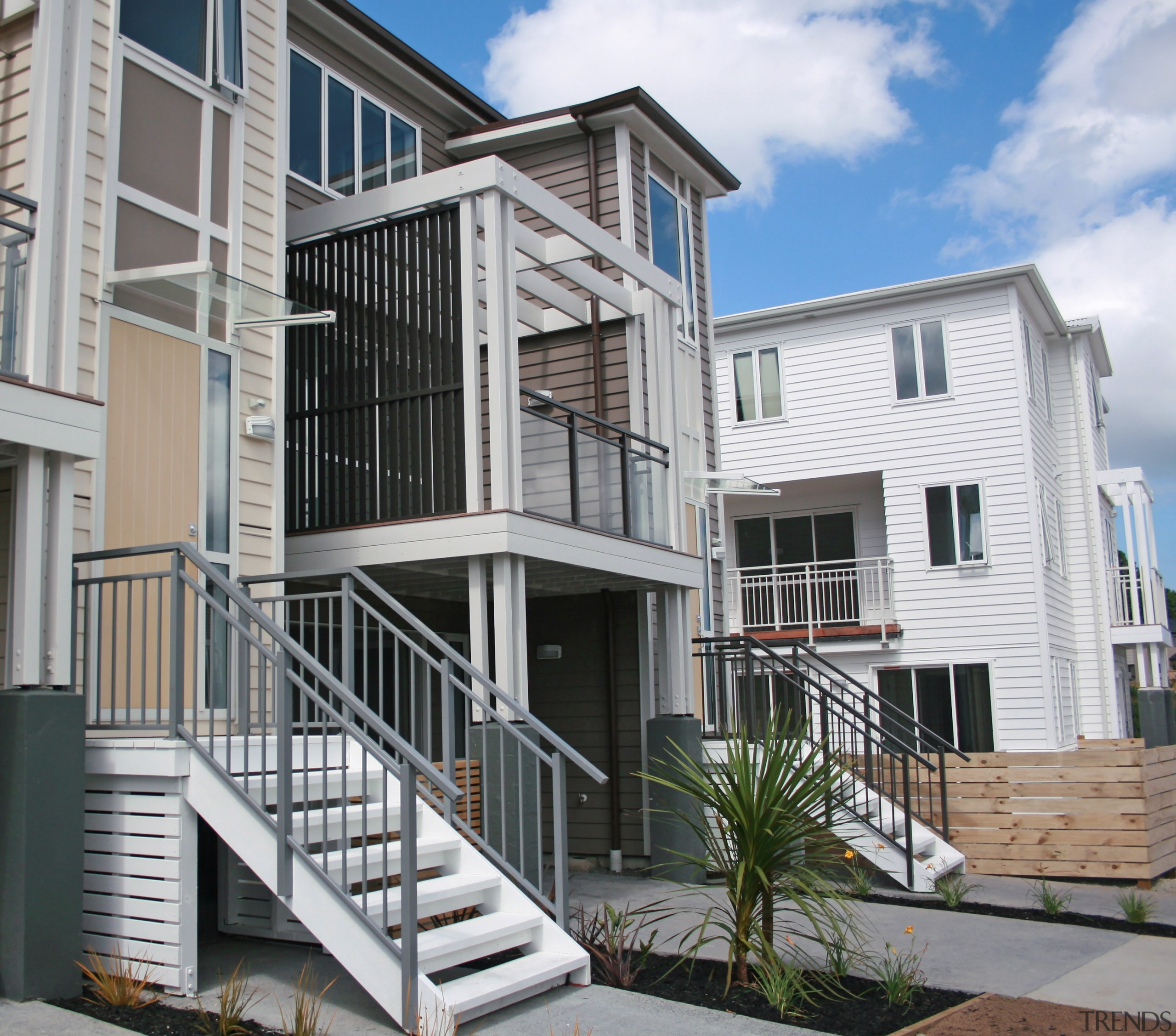 The exterior fittings installed by HomePlus are all apartment, balcony, building, condominium, deck, elevation, facade, handrail, home, house, mixed use, neighbourhood, property, real estate, residential area, siding, gray