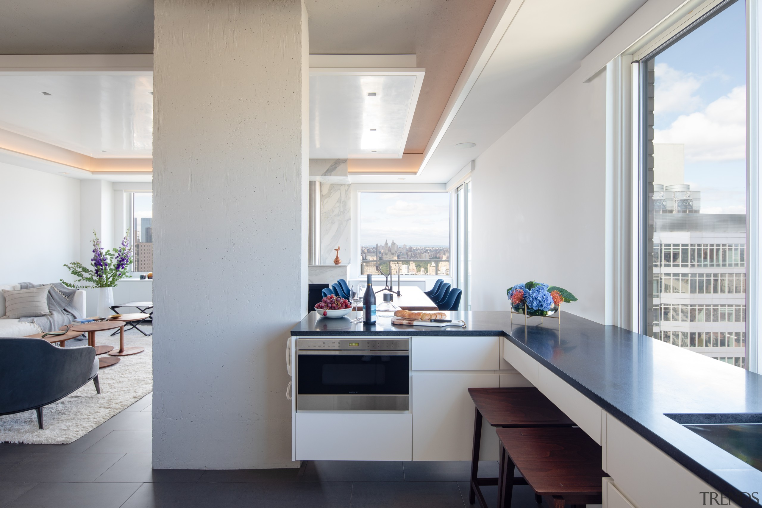 ​​​​​​​Originally an enclosed space, the new kitchen in Penthouse apartment, architecture, building, countertop, benchtop, floor, flooring, furniture, glass, home, house, interior design, kitchen, Andrew Wilkinson