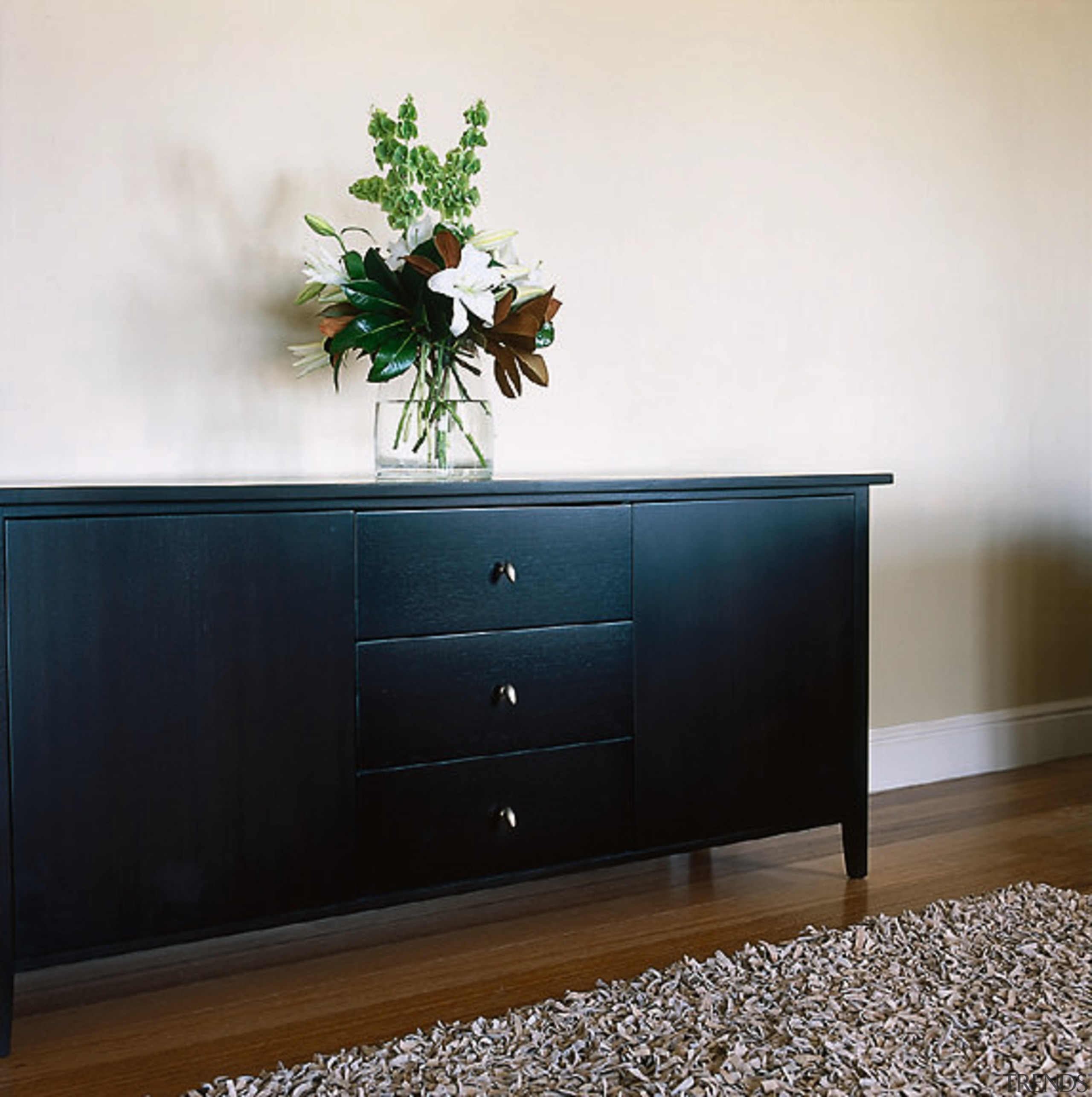 A photograph of Bos Design's Parnell buffet in chest of drawers, drawer, furniture, sideboard, table, wood stain, white, black