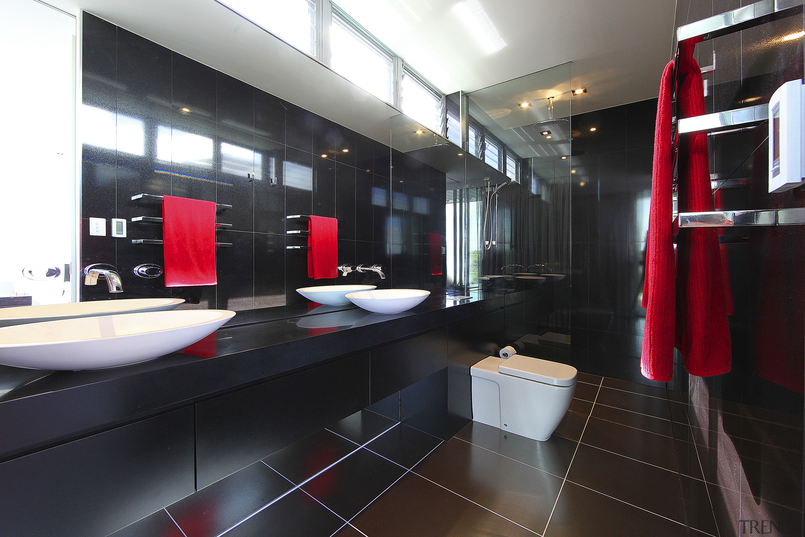Bathroom with brown tile flooring, black vanity and bathroom, interior design, room, black