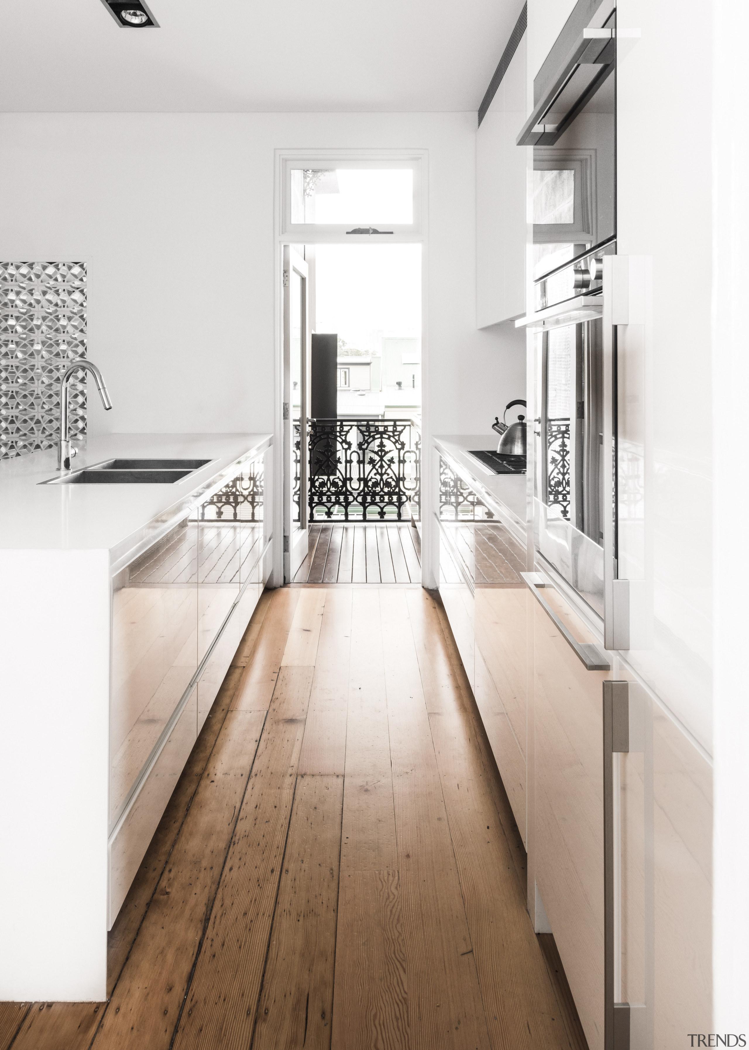 This new kitchen gains light from the breezeblock countertop, floor, flooring, interior design, kitchen, product design, tap, white