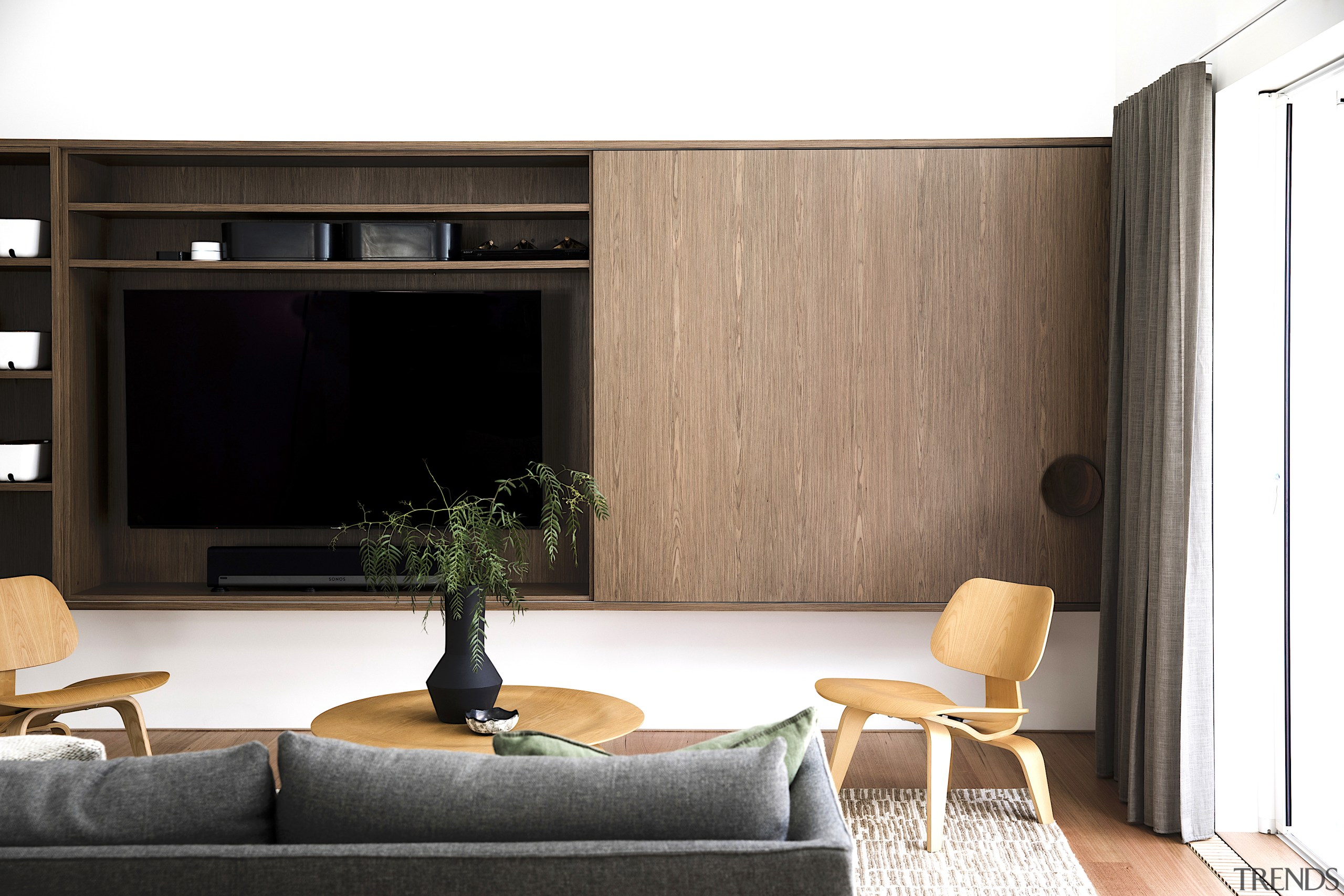 Bespoke walnut cabinetry offers handy living space functionality
