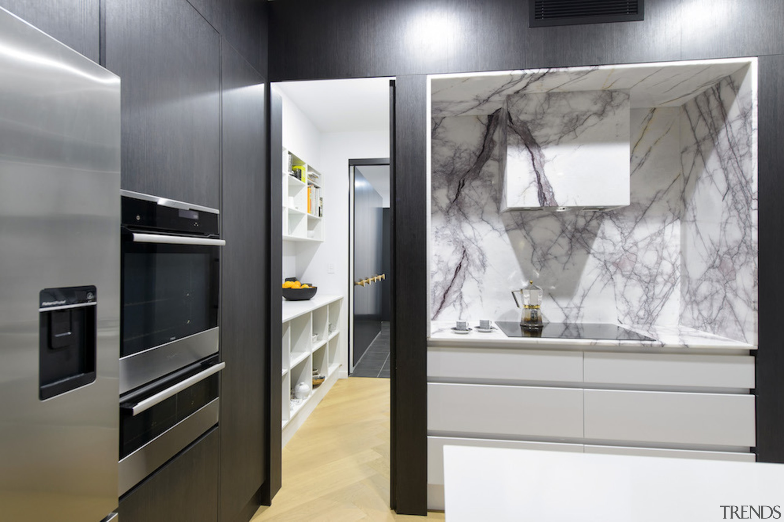 Marble surfaces give the kitchen an upmarket aesthetic. building, cabinetry, countertop, cupboard, floor, furniture, home appliance, house, interior design, kitchen, material property, property, room, wall, gray