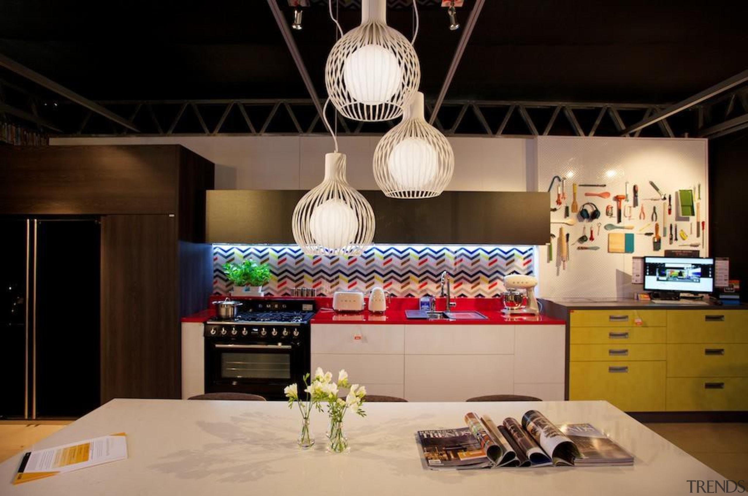 Featuring Smeg refrigerator, freestanding cooker and small appliances! ceiling, interior design, lighting, black, orange