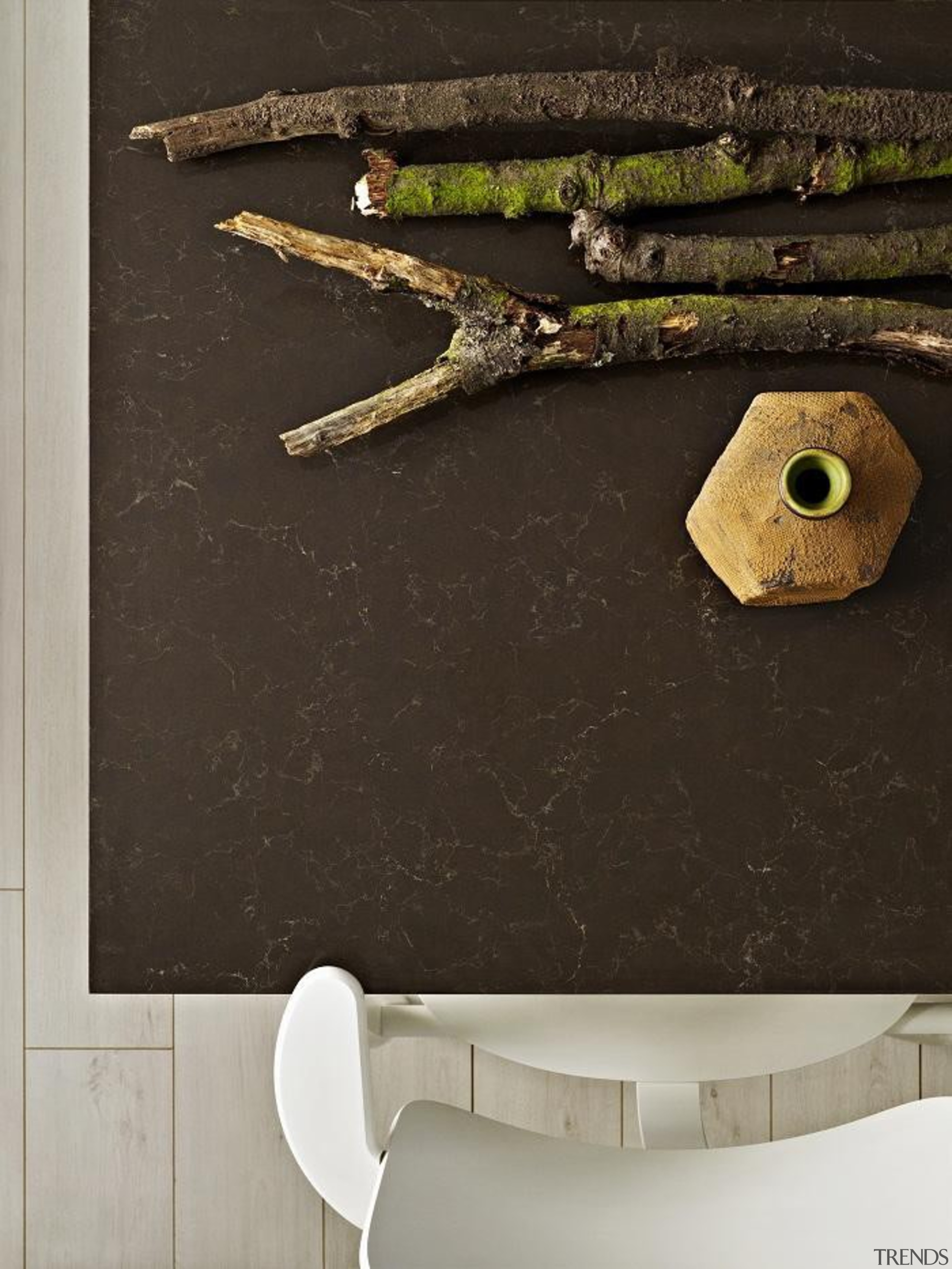A rich fusion of lush, deep browns with floor, product design, wall, wood, black, gray