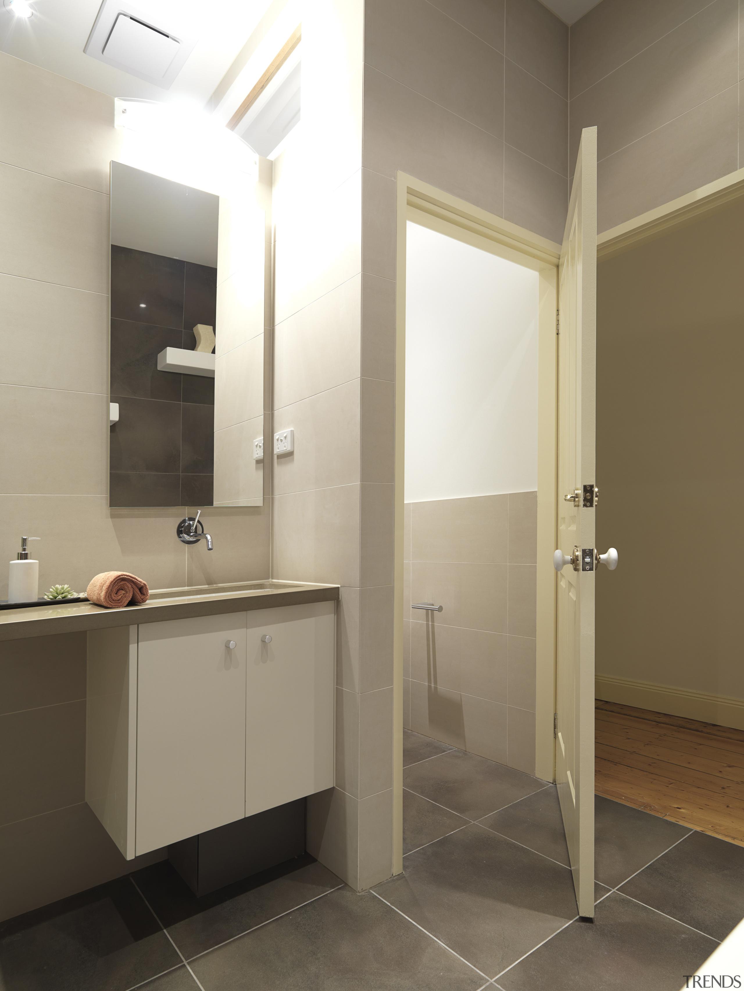 View of bathroom with vanity and toilet, features bathroom, bathroom accessory, floor, interior design, plumbing fixture, product design, room, sink, brown, white