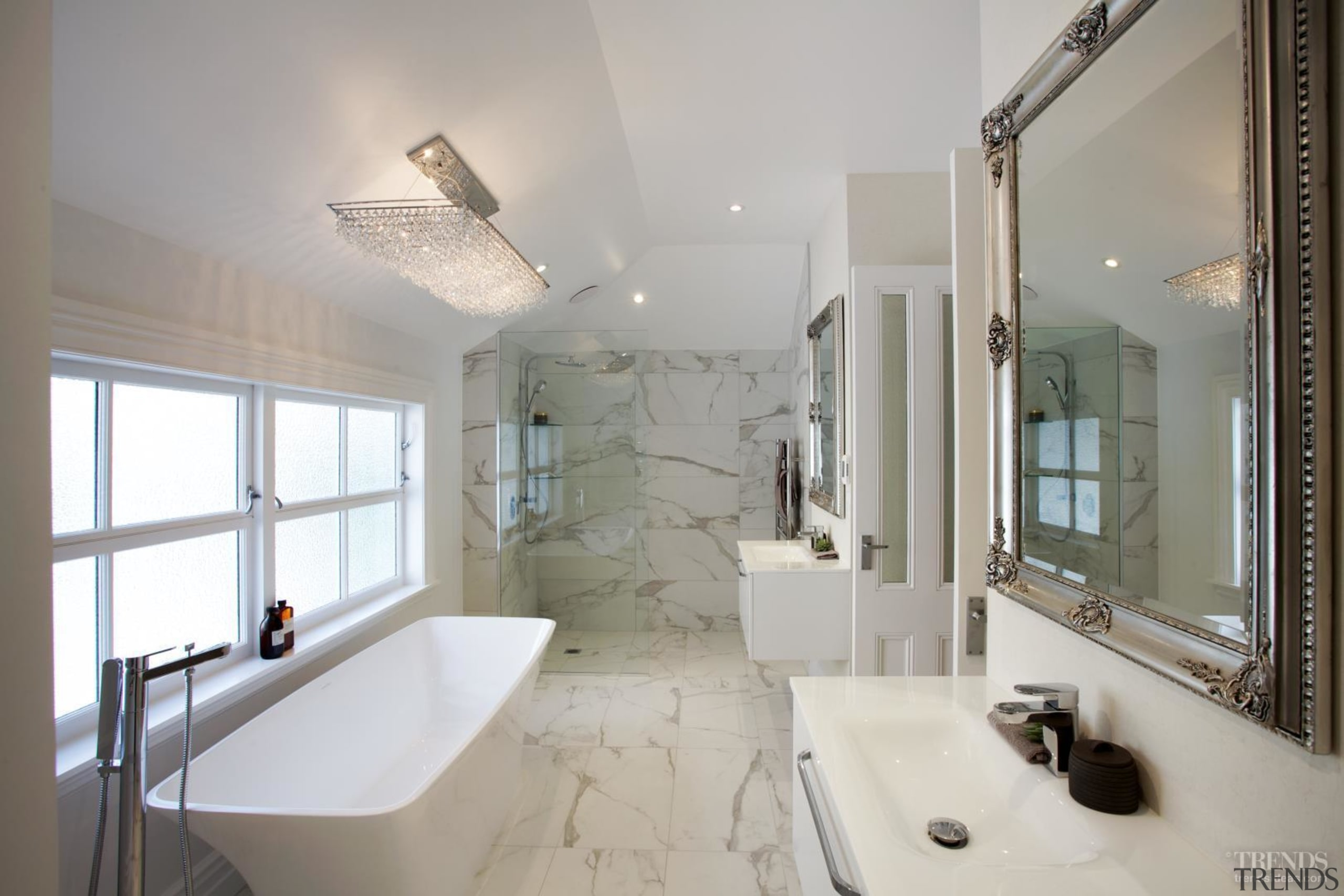 A sleek bath filler contrasts old-world mirror frames, architecture, bathroom, ceiling, daylighting, estate, home, interior design, property, real estate, room, window, gray