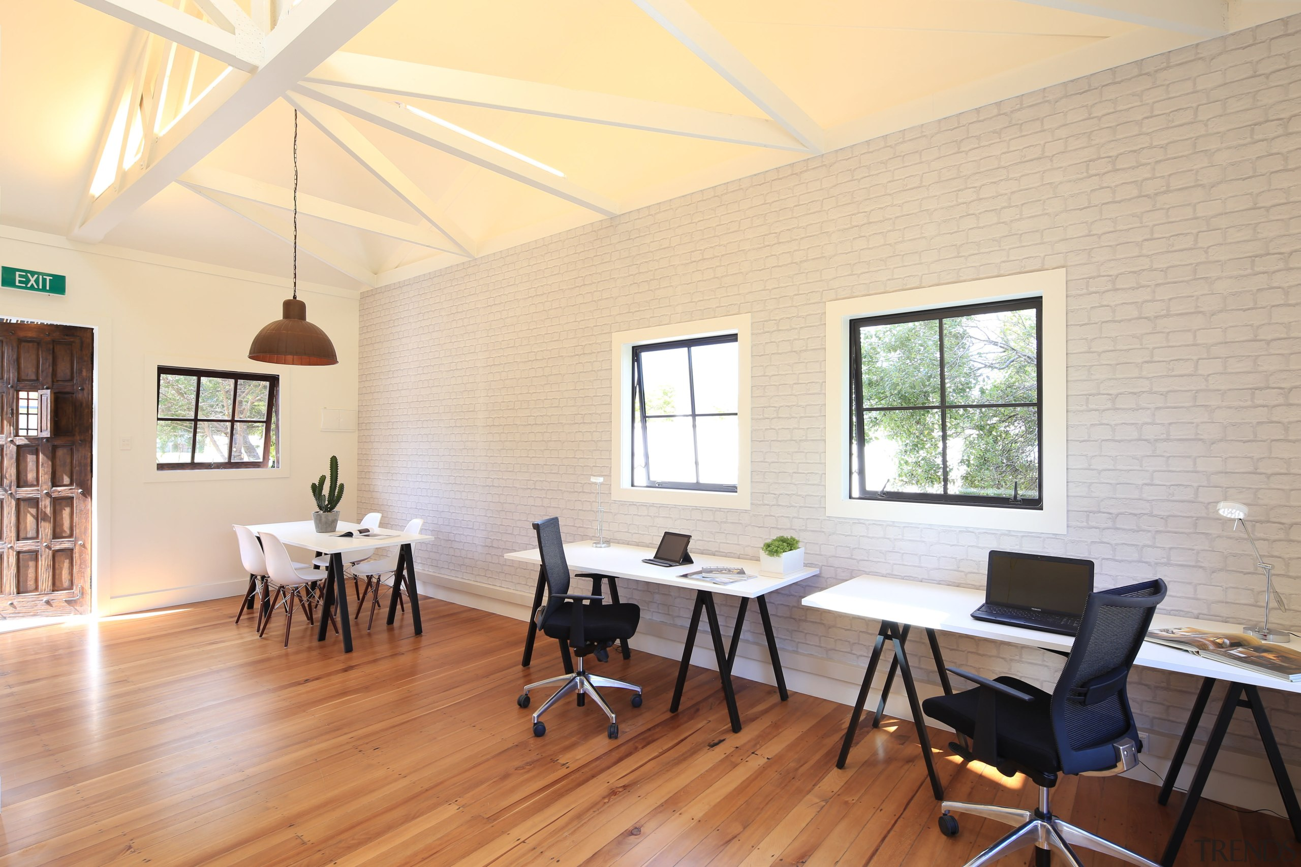 Light-filled and airy, the studios are finished in ceiling, daylighting, dining room, floor, flooring, furniture, house, interior design, real estate, room, table, window, wood flooring, orange