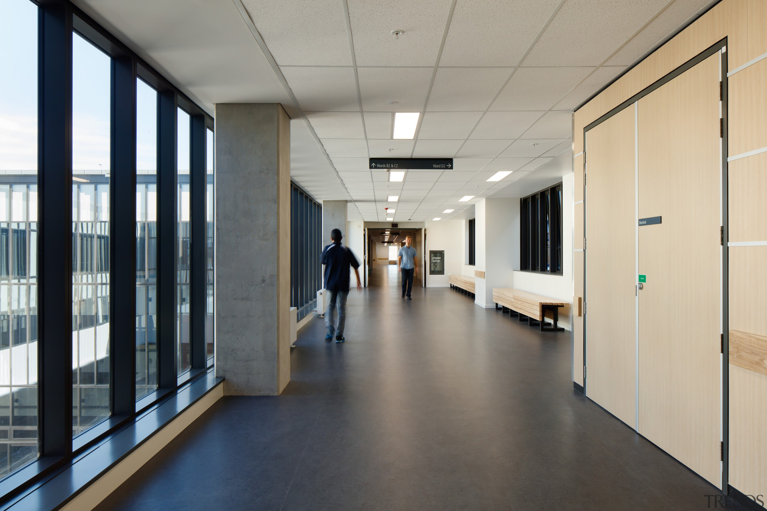 One of the many connecting corridors in the floor, flooring, institution, gray