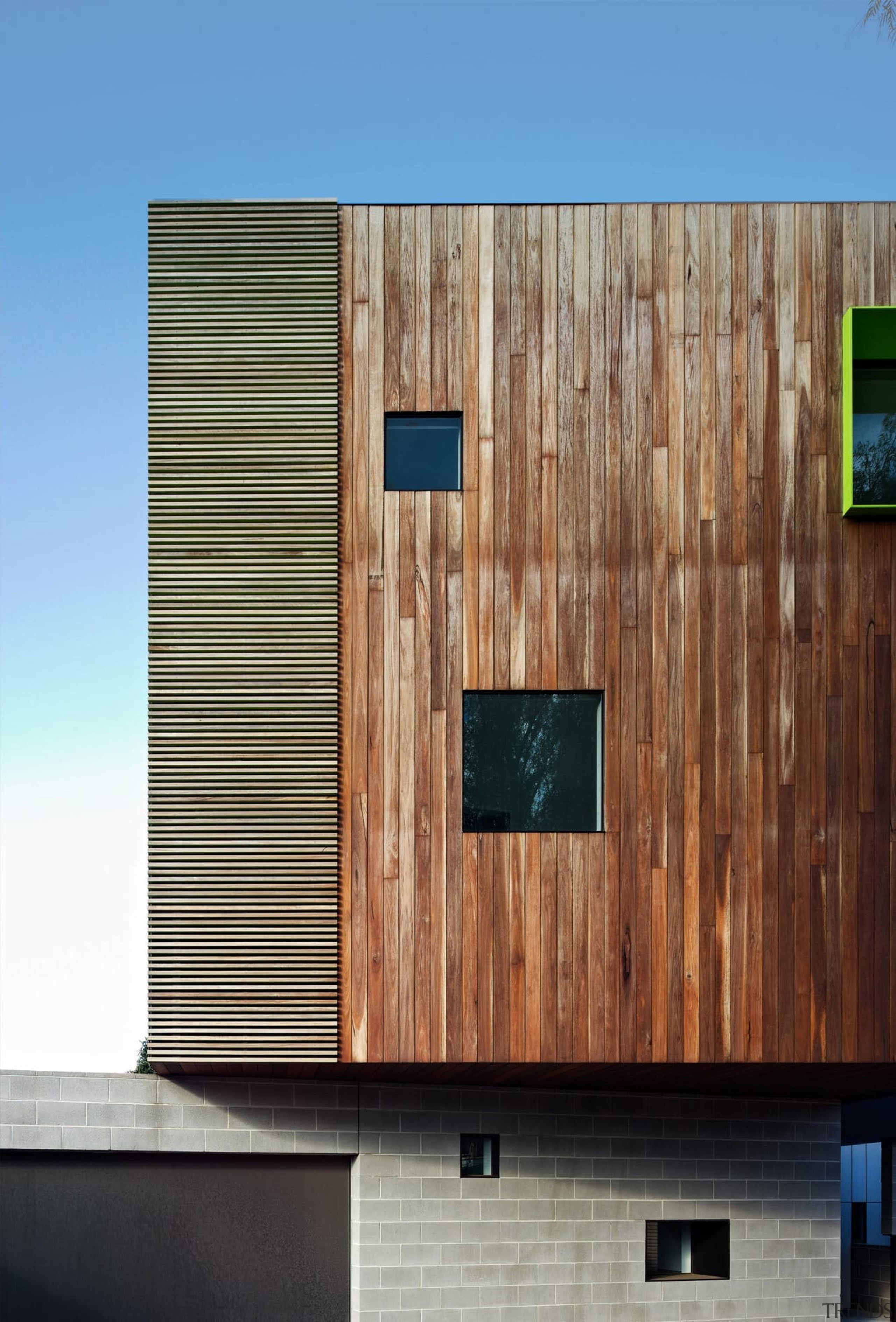 Interspaced windows break up the wood facade - architecture, building, facade, home, house, siding, wall, wood, wood stain