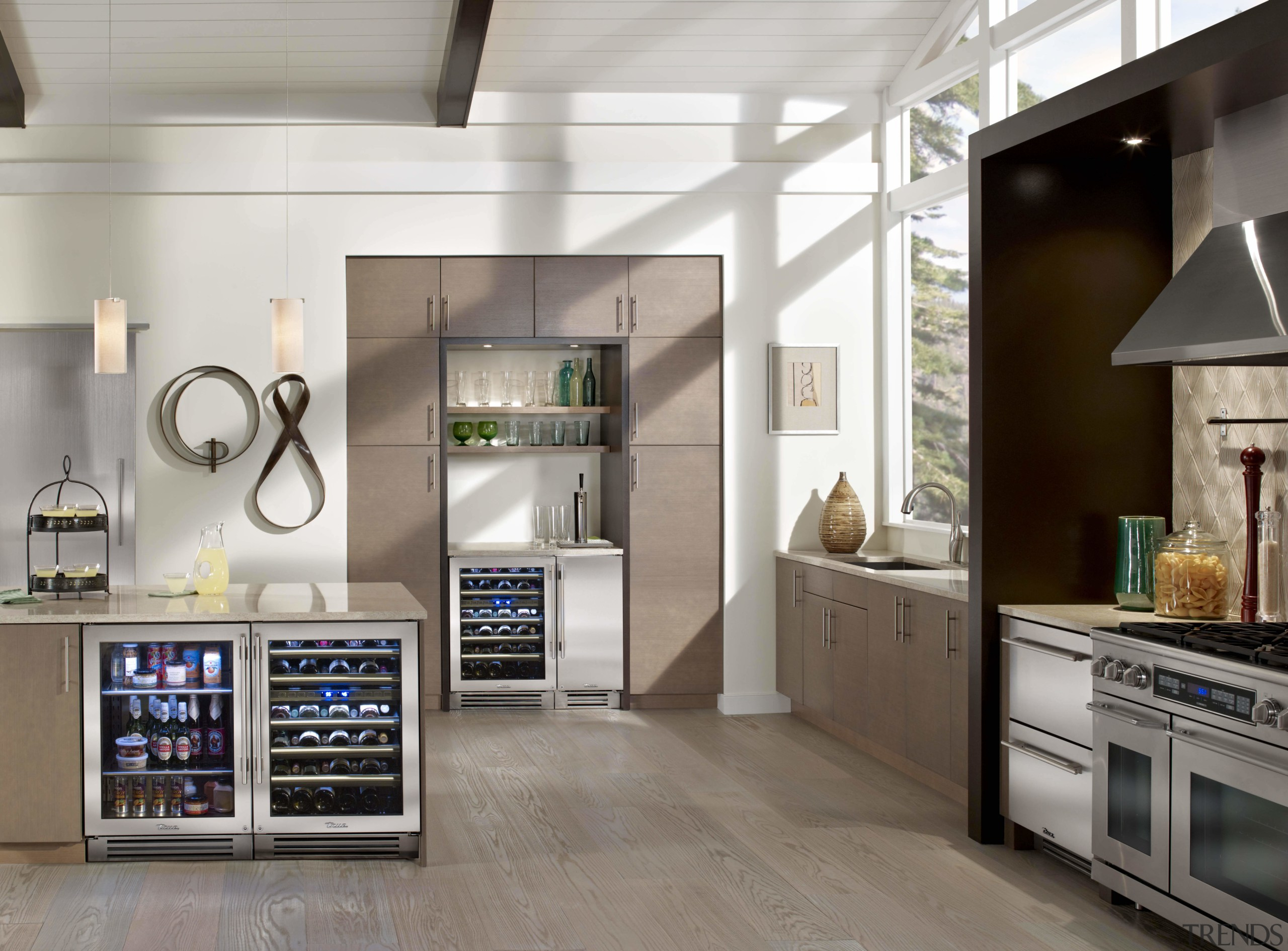 this kitchen is organised into a number of countertop, home appliance, interior design, kitchen, kitchen appliance, major appliance, refrigerator, gray