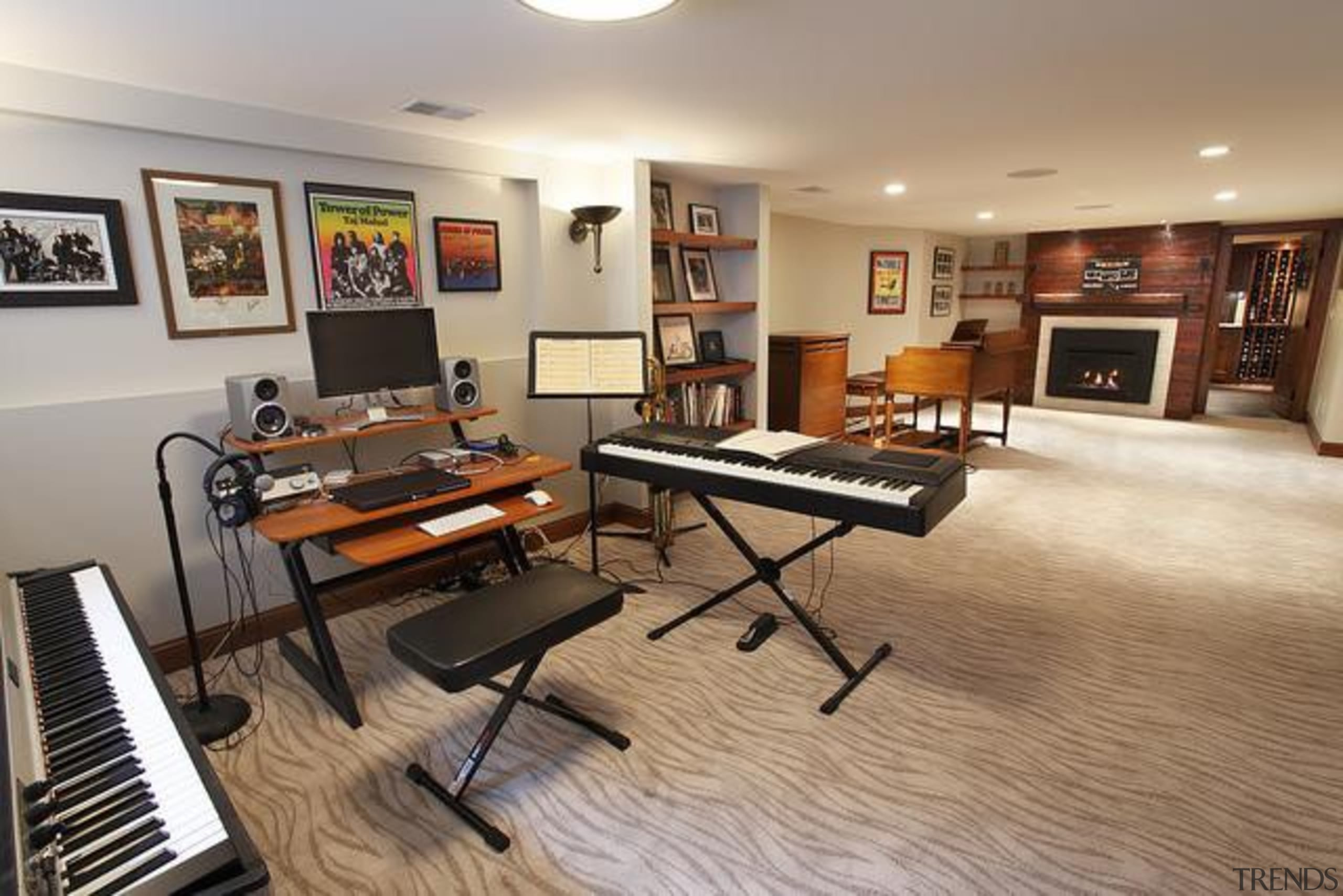 Because of its expansive and wide-open layout, a floor, flooring, hardwood, interior design, keyboard, living room, musical instrument, piano, real estate, room, wood flooring, gray, brown