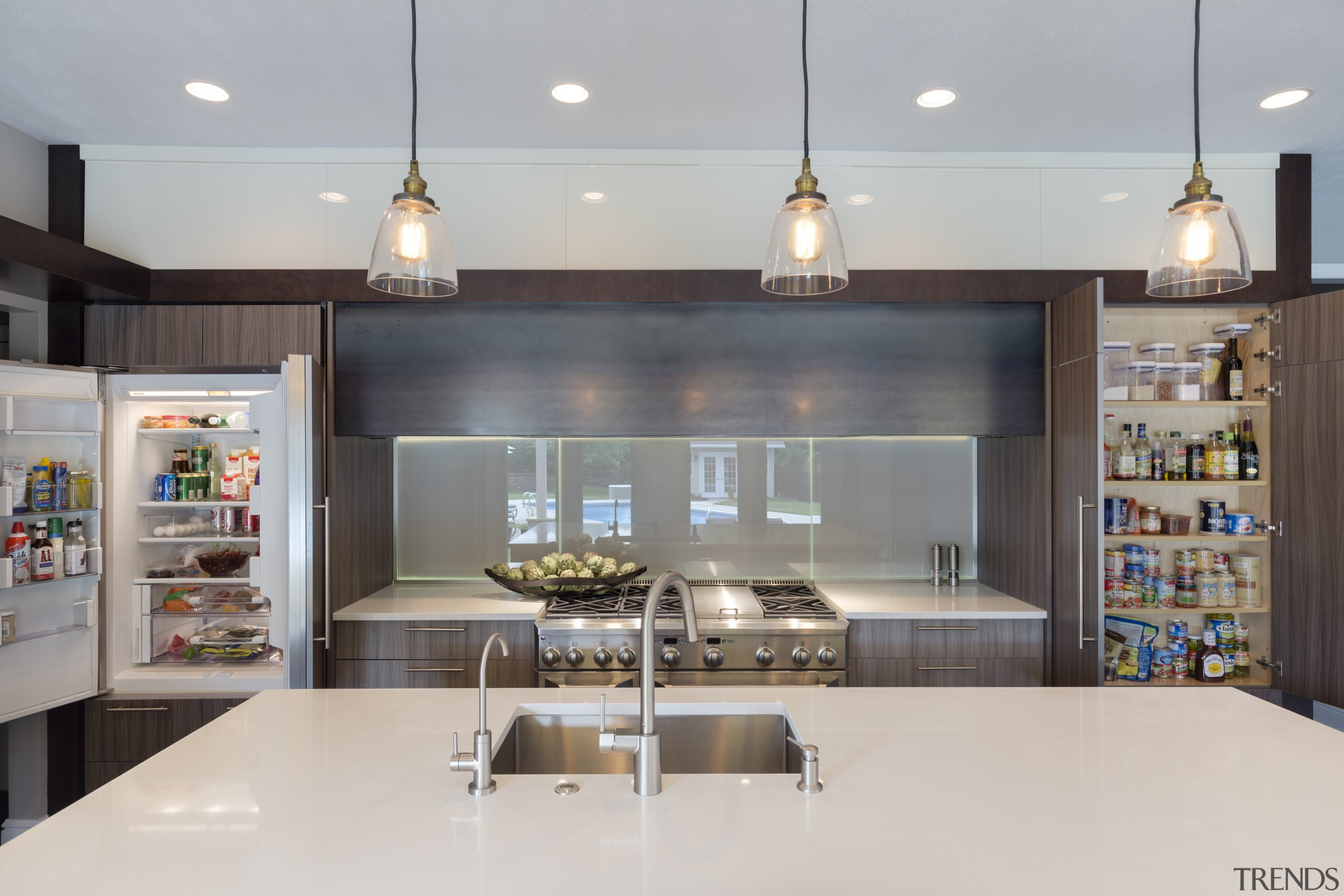 With integrated refrigeration to the left and a countertop, interior design, kitchen, gray