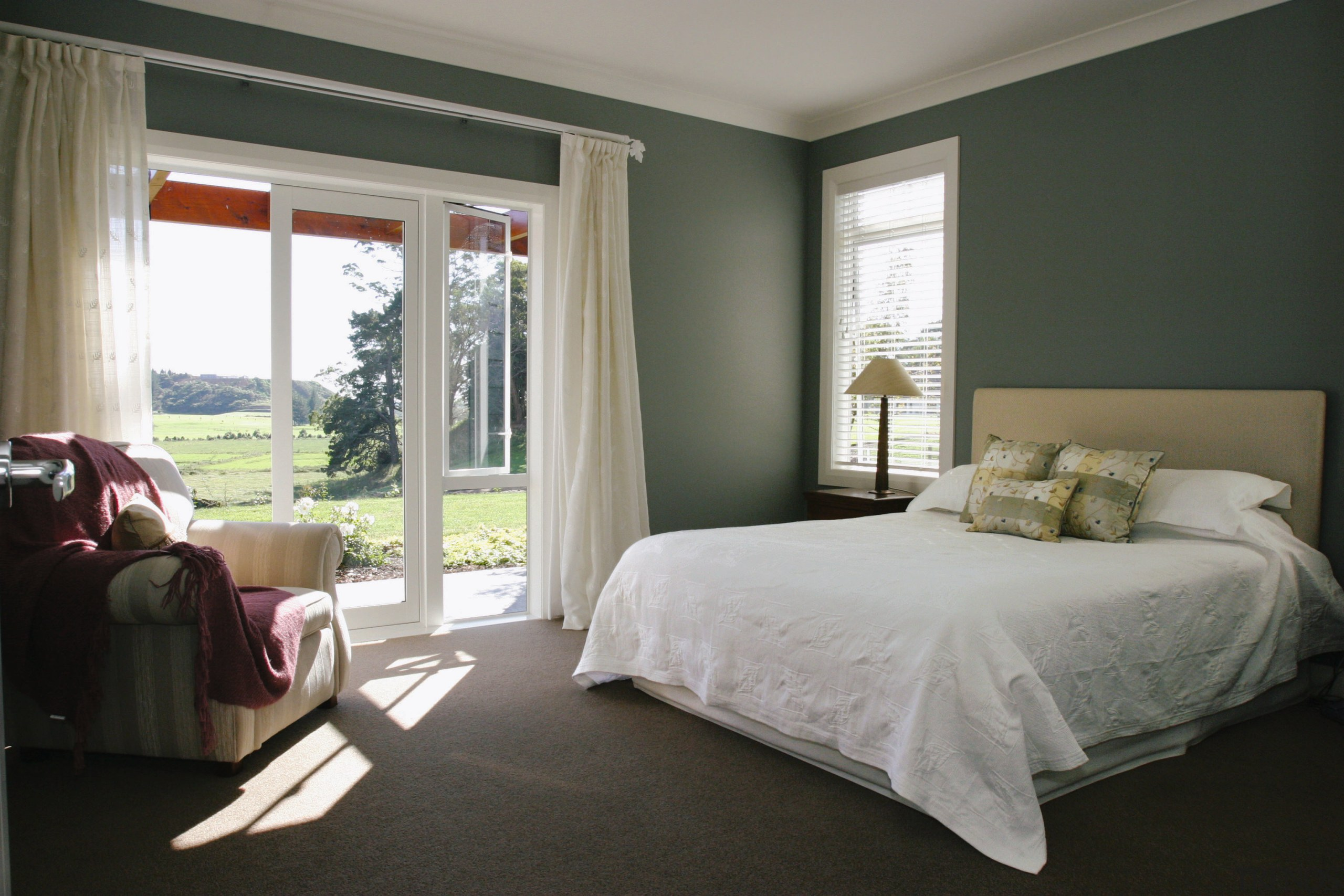breathtaking green bedroom walls white furniture | A view of a bedroom, dark green wal... - Gallery - 2 | Trends