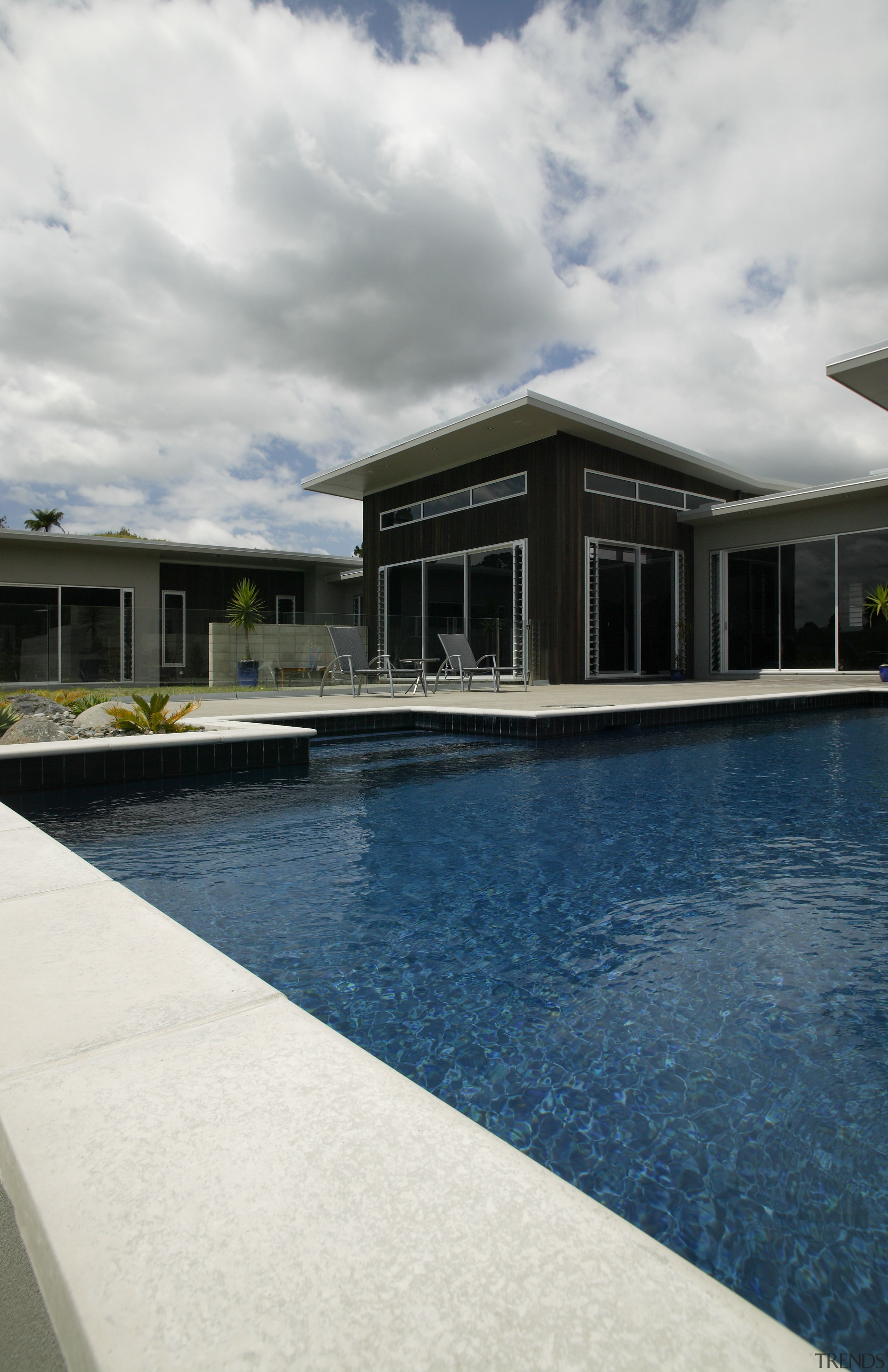 view of pool by Pool Resources. - view architecture, cloud, estate, home, house, property, real estate, reflection, sky, swimming pool, water, white