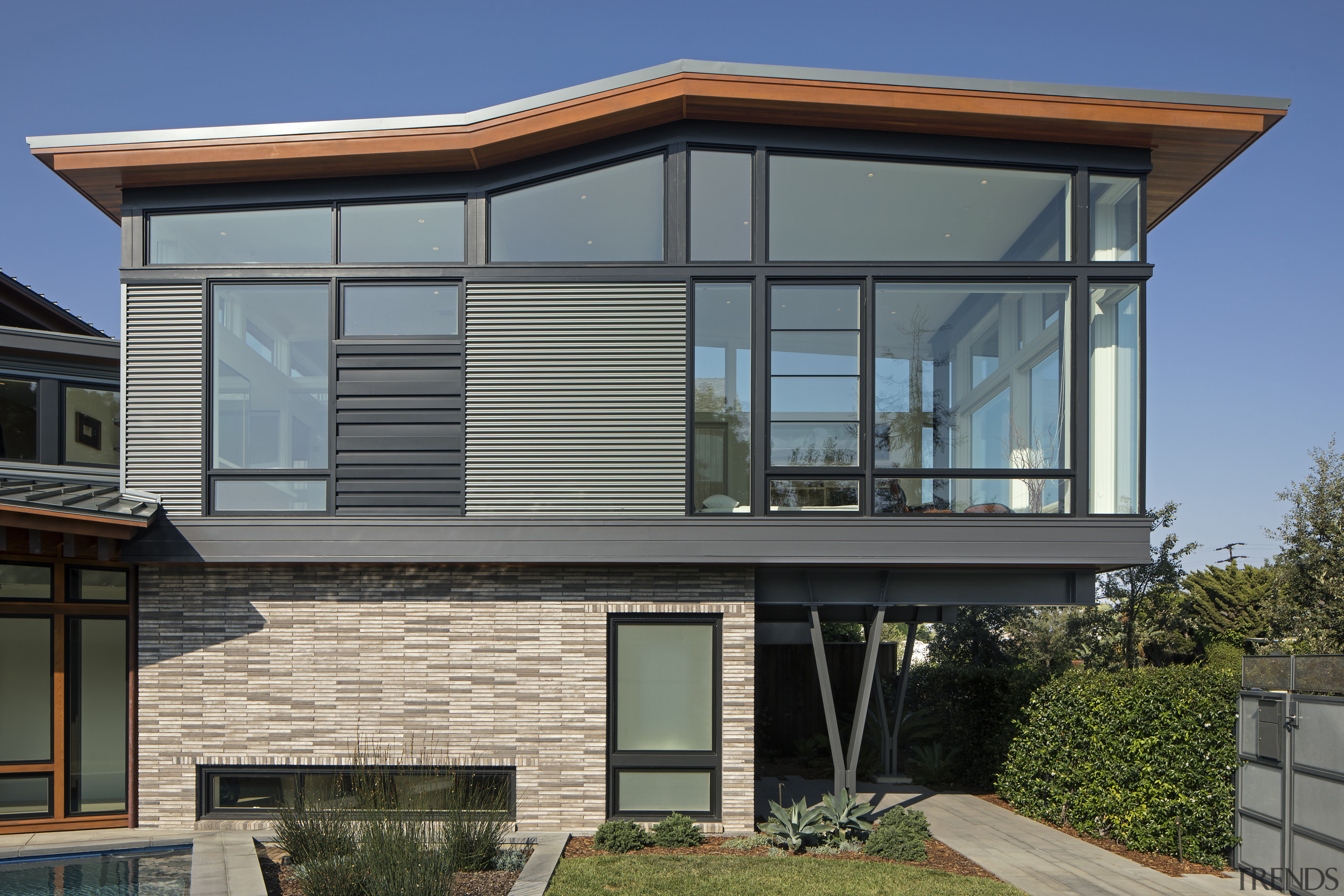 The roof shape above the private bedroom wing architecture, building, elevation, facade, home, house, property, real estate, residential area, siding, window, gray, black