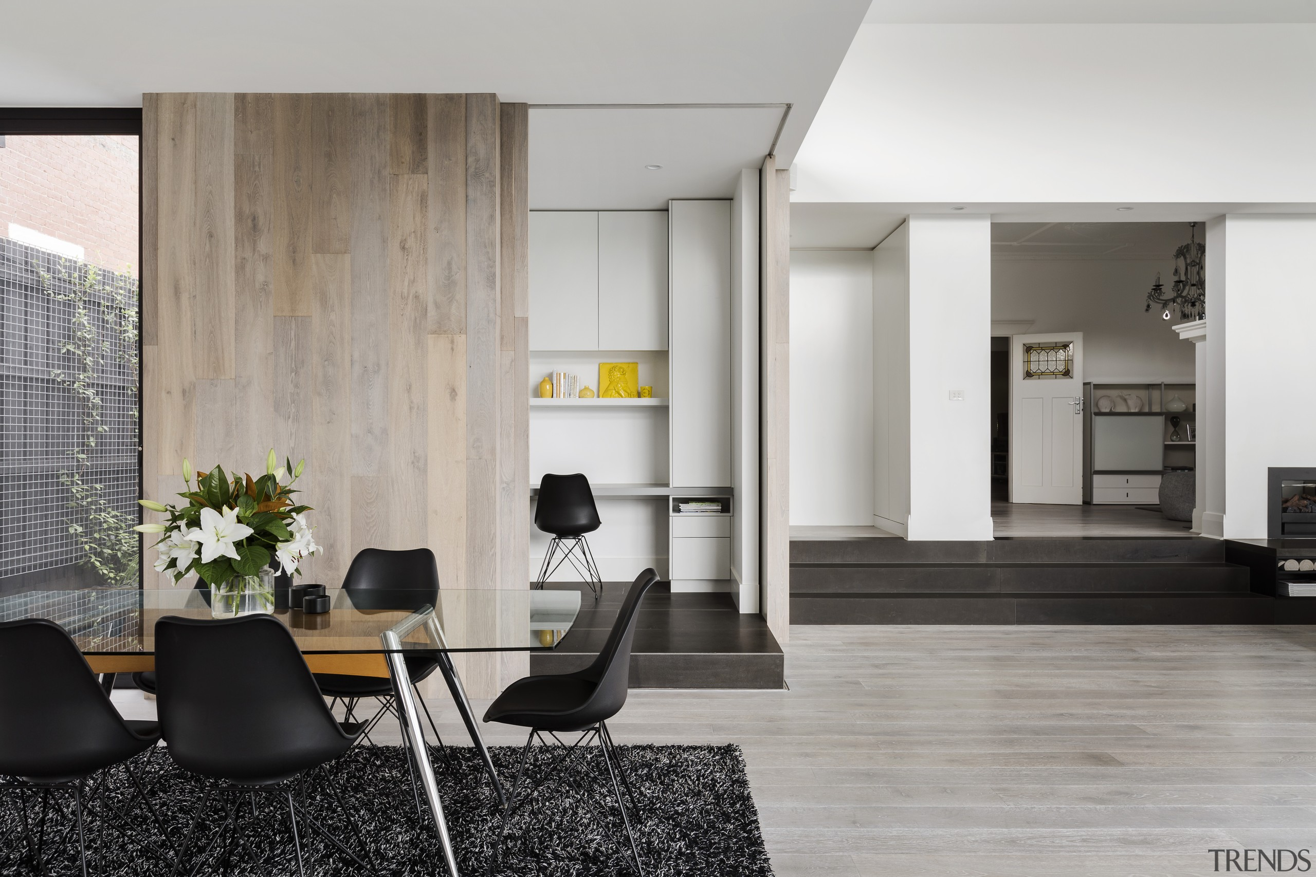 When the doors are shut on this wood-clad architecture, floor, flooring, furniture, house, interior design, living room, table, wood flooring, gray
