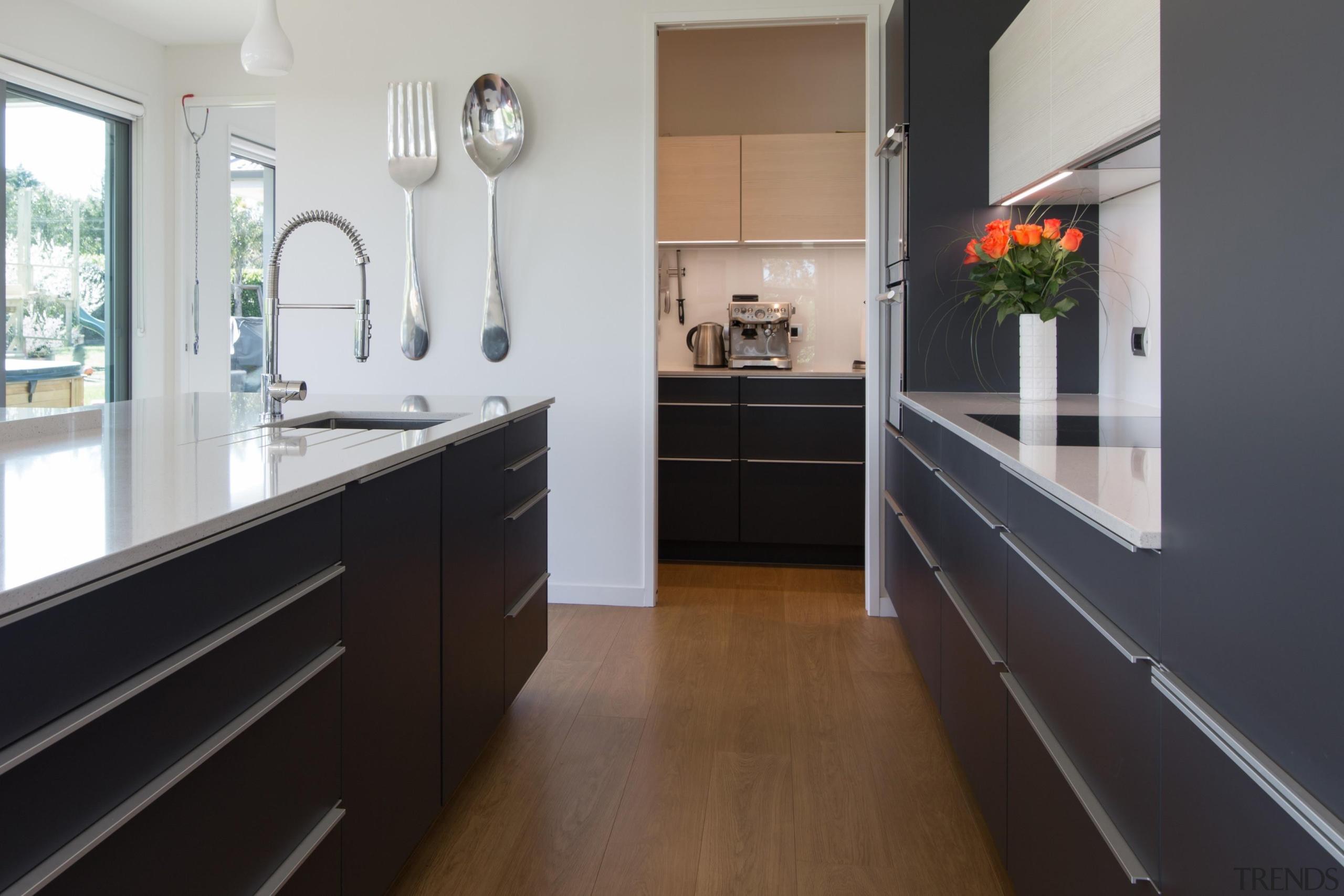 Head on view of the scullery just off cabinetry, countertop, cuisine classique, floor, flooring, hardwood, interior design, kitchen, room, wood flooring, gray, black