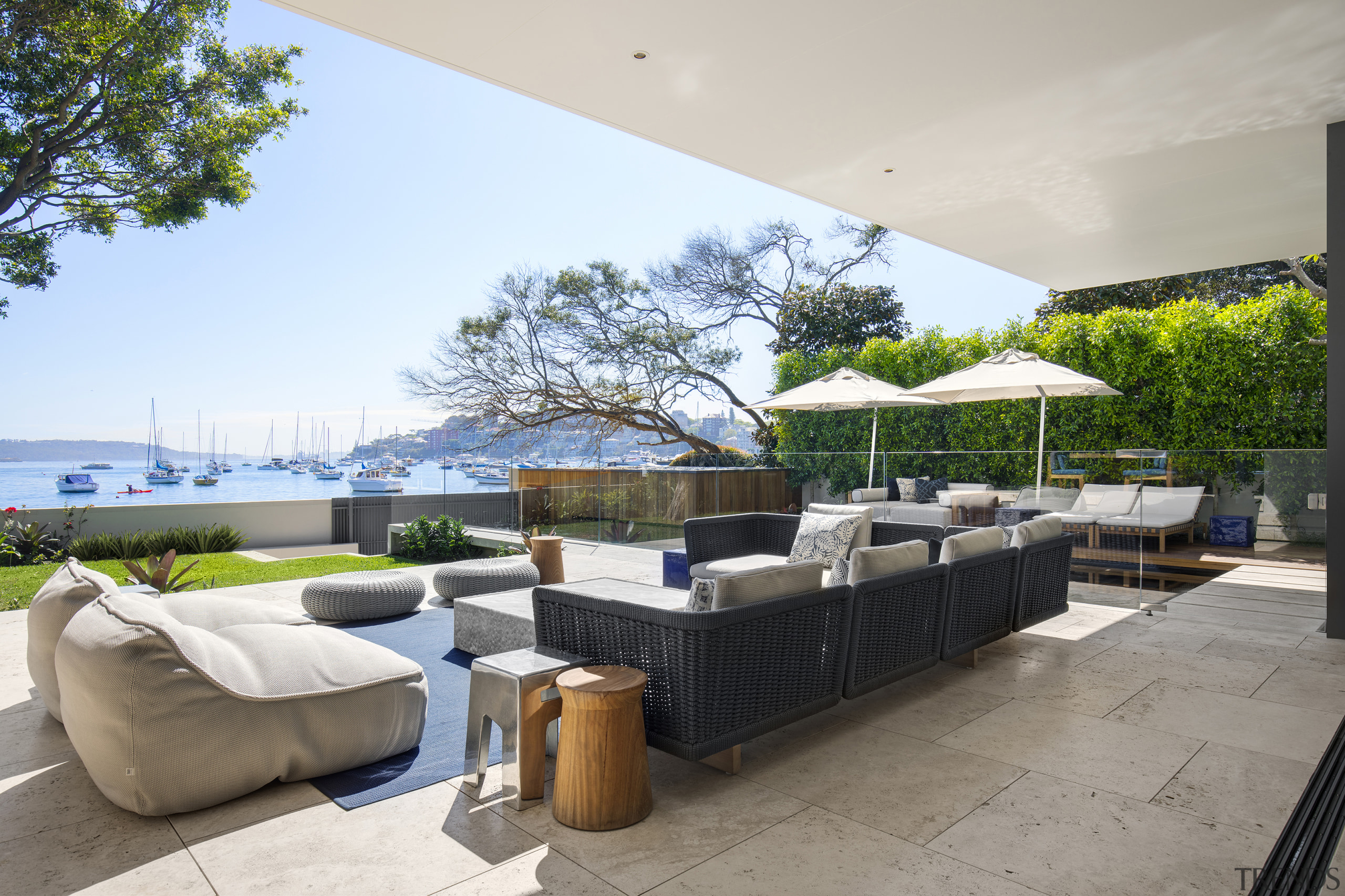 ​​​​​​​Extend your living area to the outdoors to architecture, home, house, outdoor patio, outdoor furniture, umbrella, SAOTA