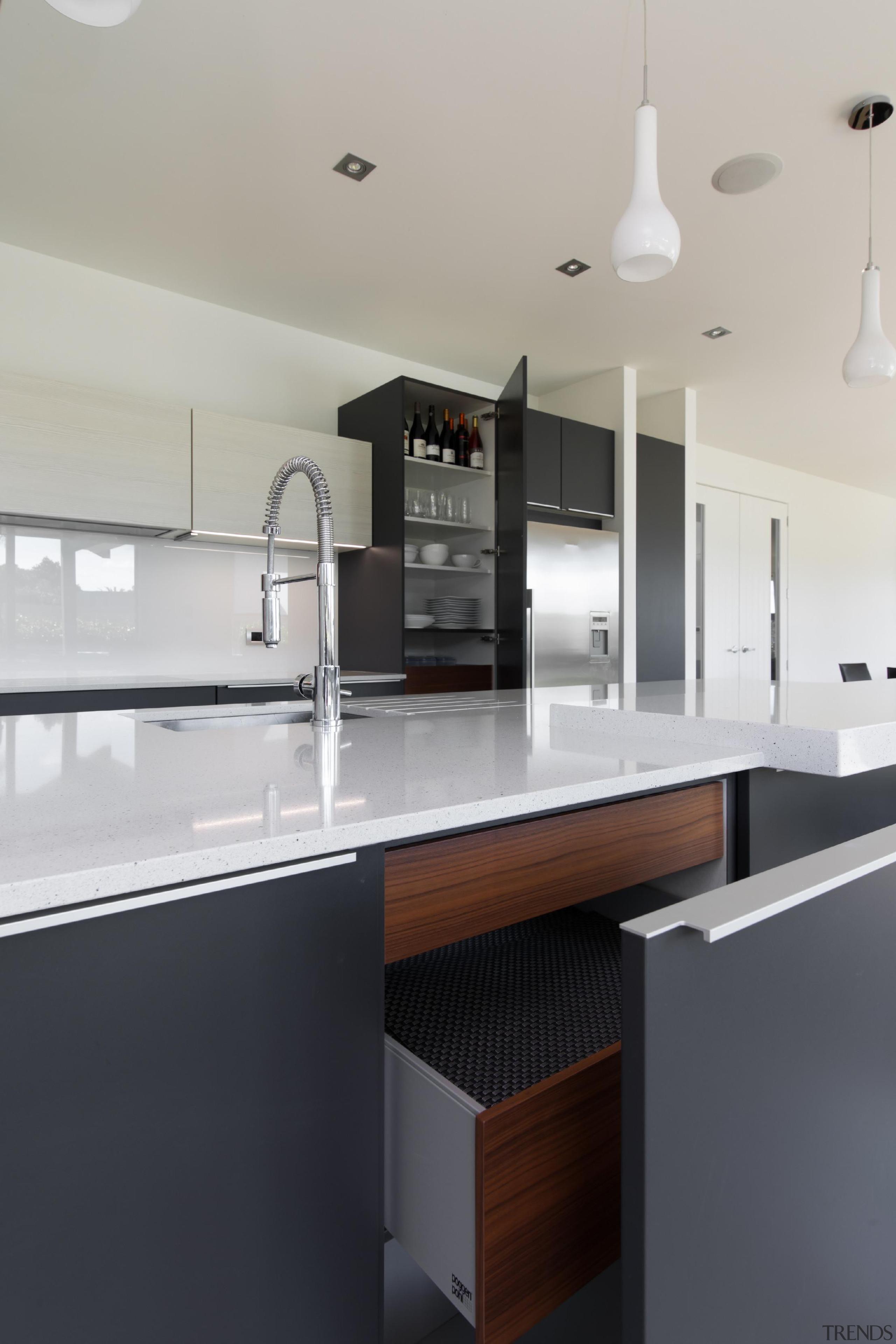 Dark blue and white themed kitchen designFor more cabinetry, countertop, interior design, kitchen, product design, room, sink, gray, black