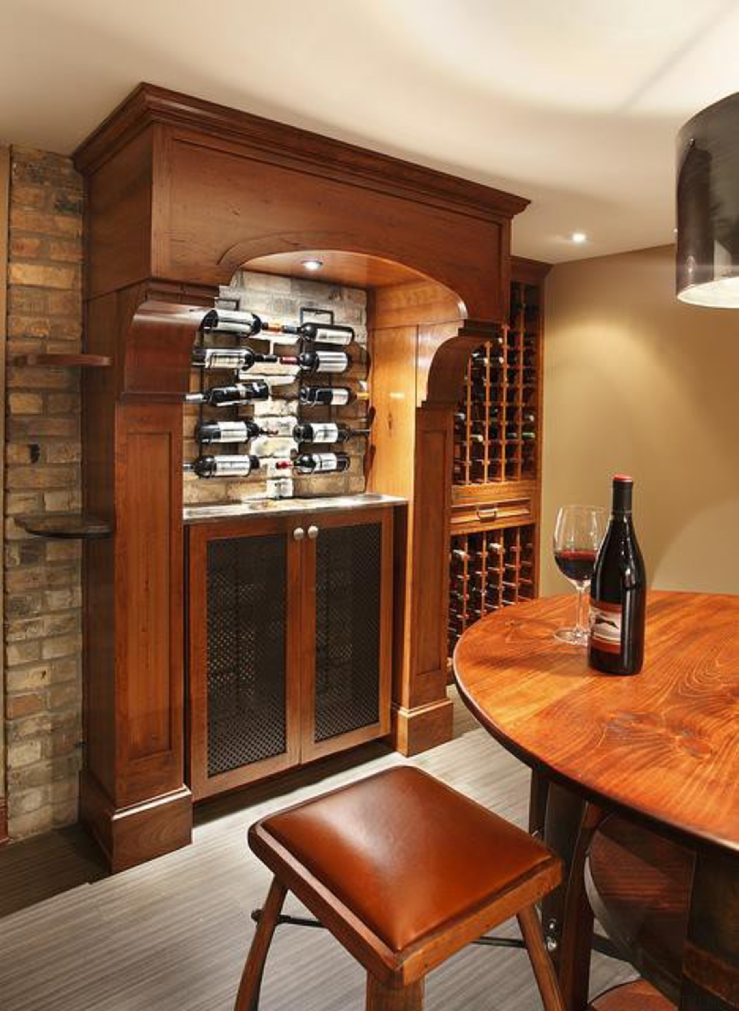 Because of its expansive and wide-open layout, a bookcase, cabinetry, furniture, interior design, shelf, shelving, wine cellar, brown, orange