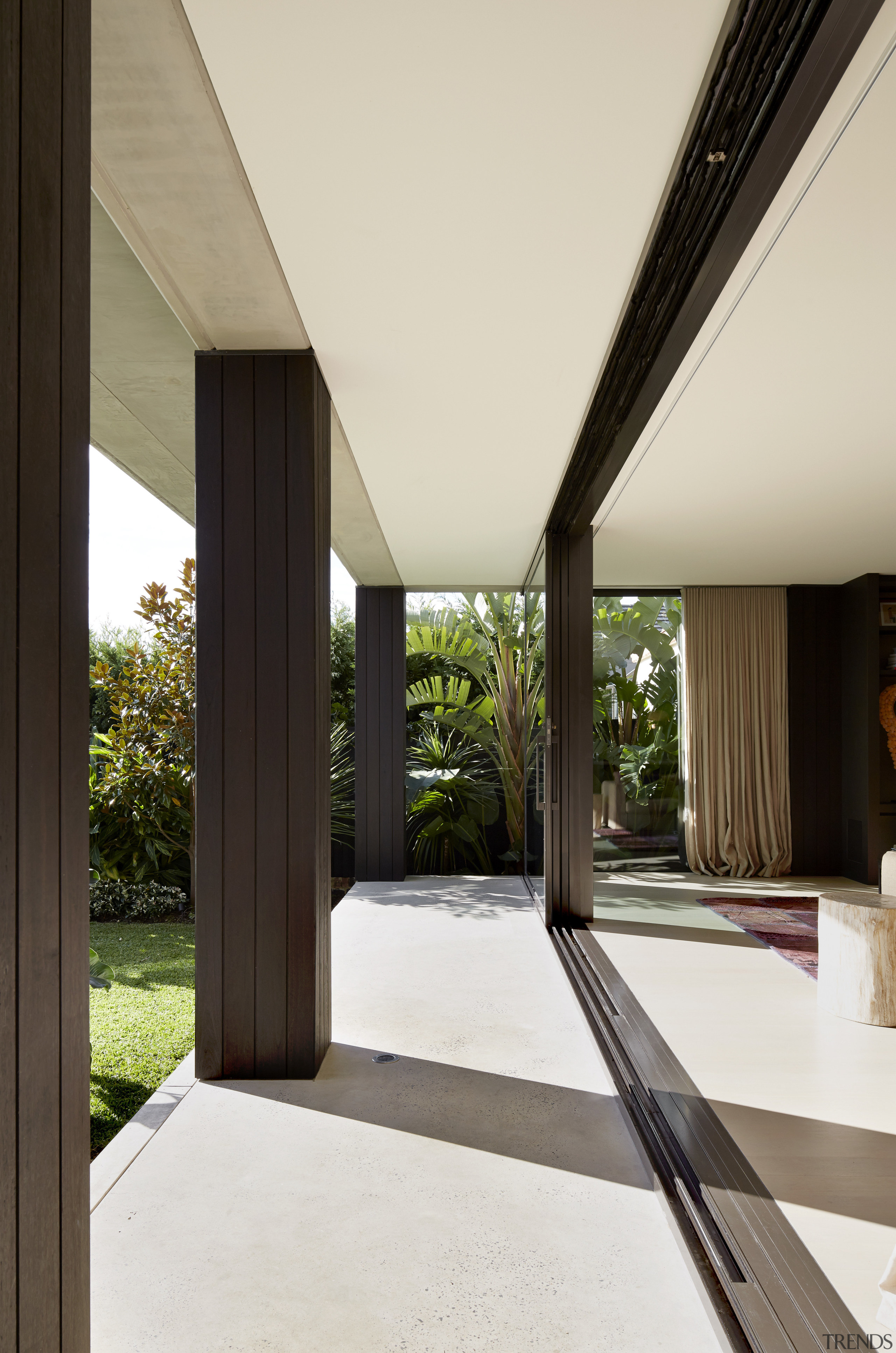 With sliders drawn back, the exterior and interior architecture, daylighting, estate, house, interior design, property, real estate, window, white, black