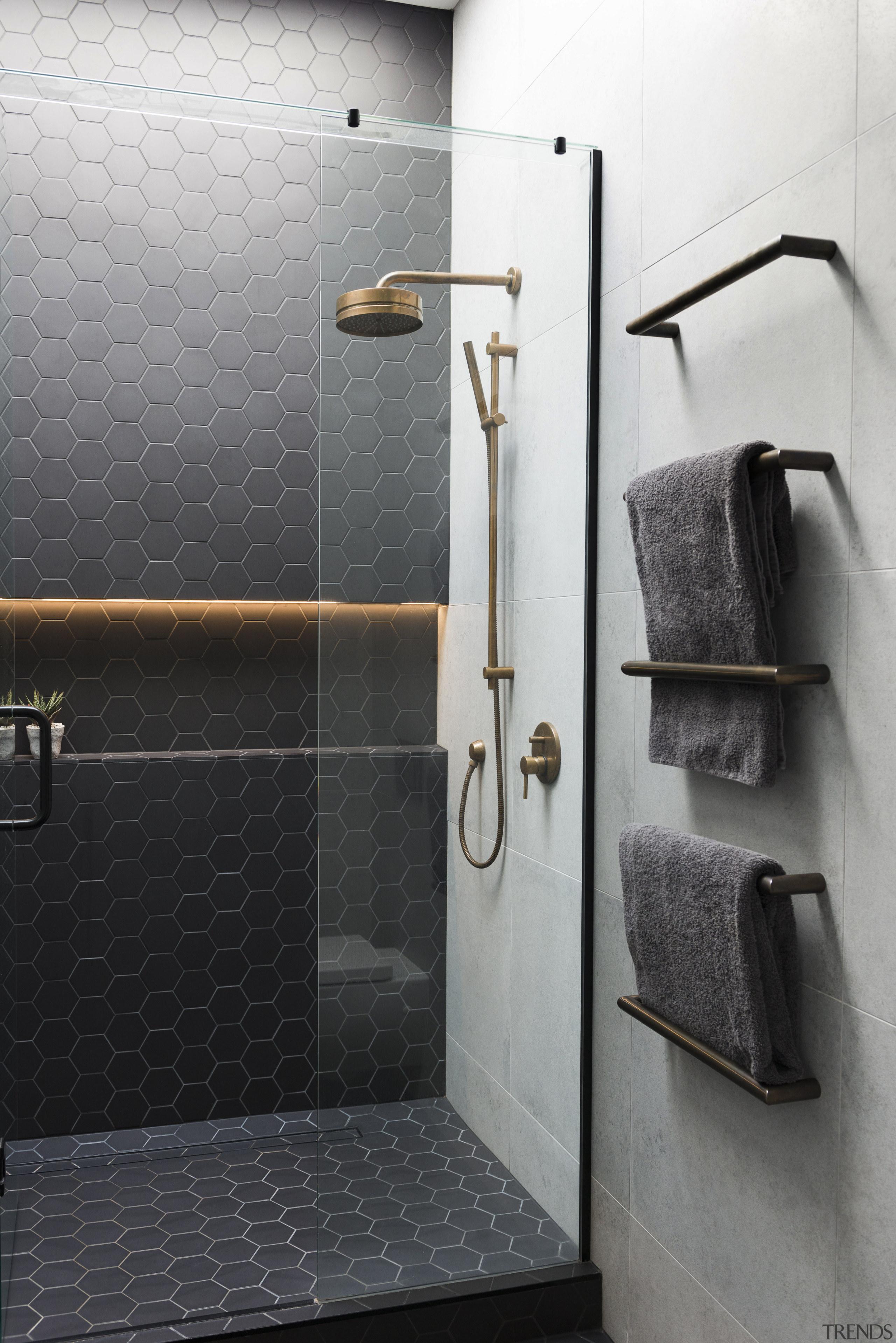 An LED-lit shower niche and under-vanity lighting add bathroom, floor, flooring, plumbing fixture, product design, room, tap, tile, wall, black, gray