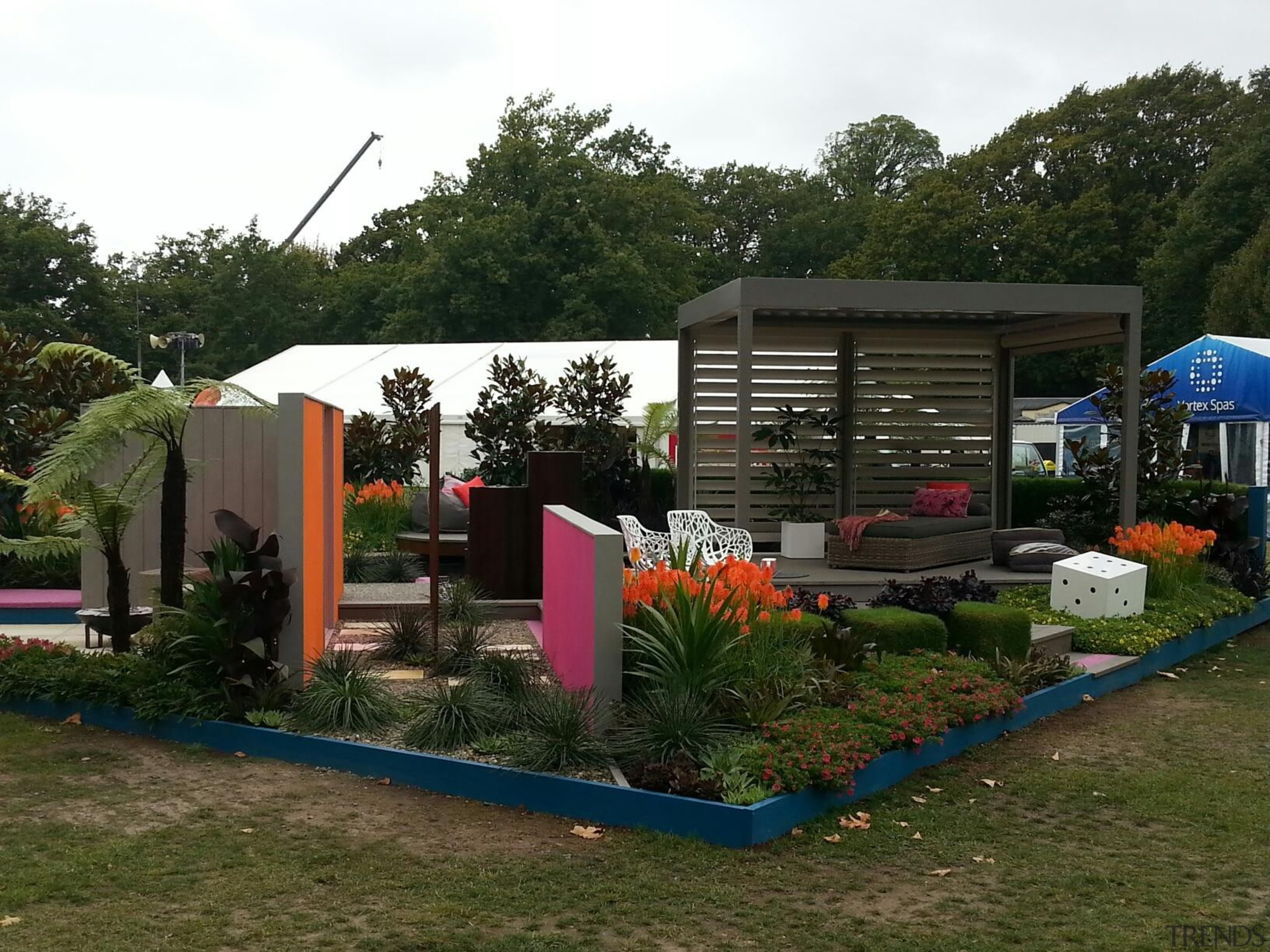 The Louvretec stand at the Ellerslie Flower Show backyard, canopy, garden, house, outdoor structure, plant, real estate, recreation, roof, shed, tree, yard, brown