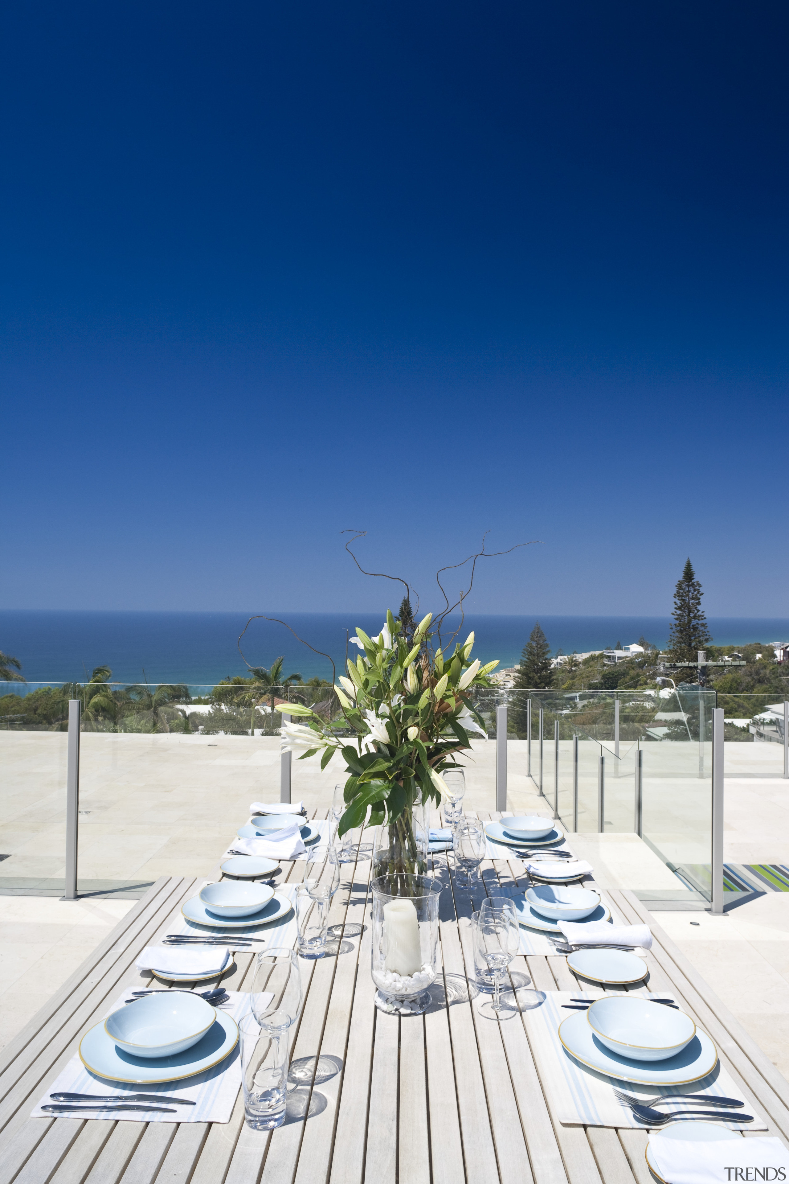 View of rooftop terrace which features paving, outdoor leisure, real estate, resort, sea, sky, swimming pool, vacation, blue, white
