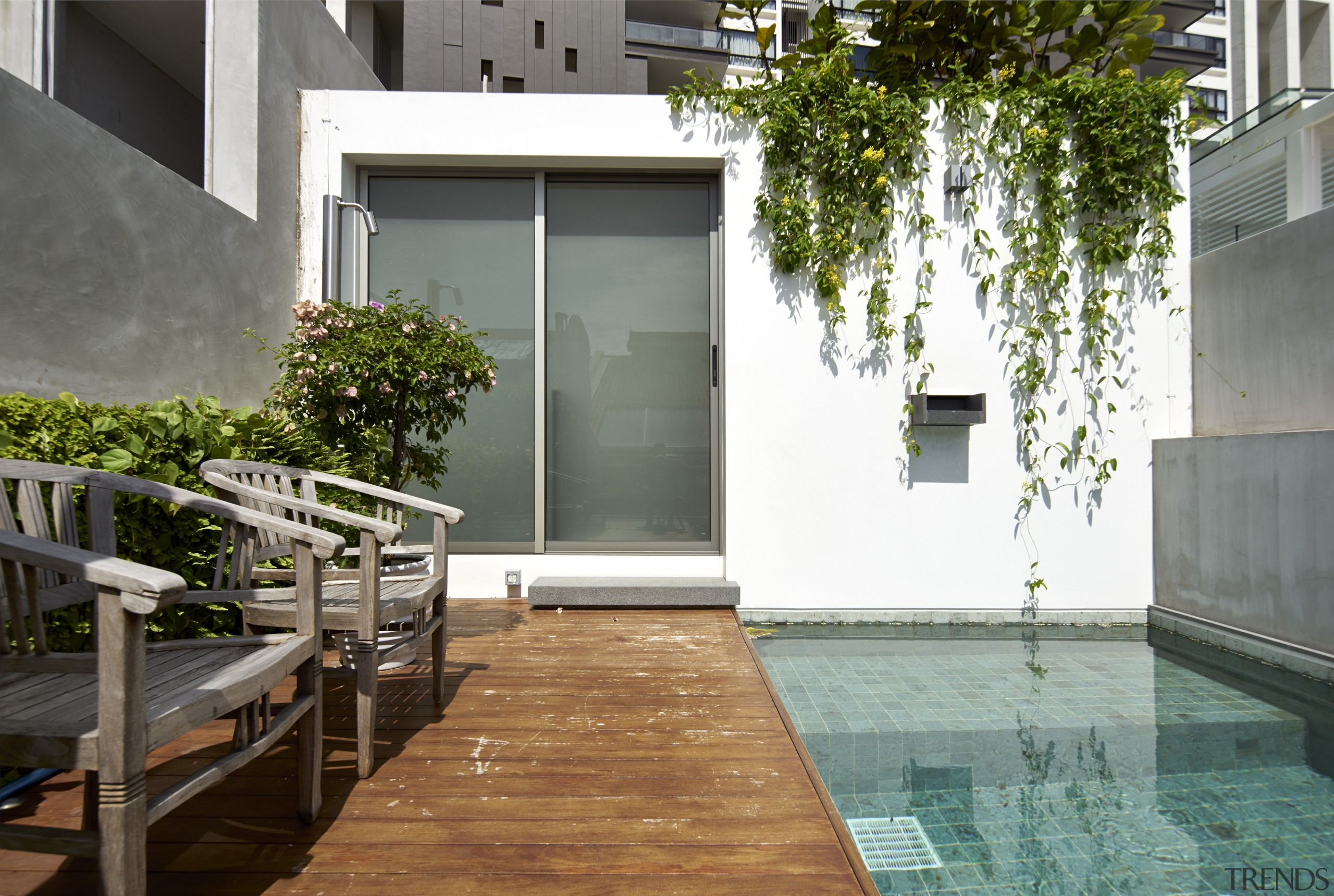 A rooftop deck and swimming pool are located apartment, architecture, backyard, condominium, courtyard, facade, home, house, interior design, property, real estate, residential area, swimming pool, water, window, gray