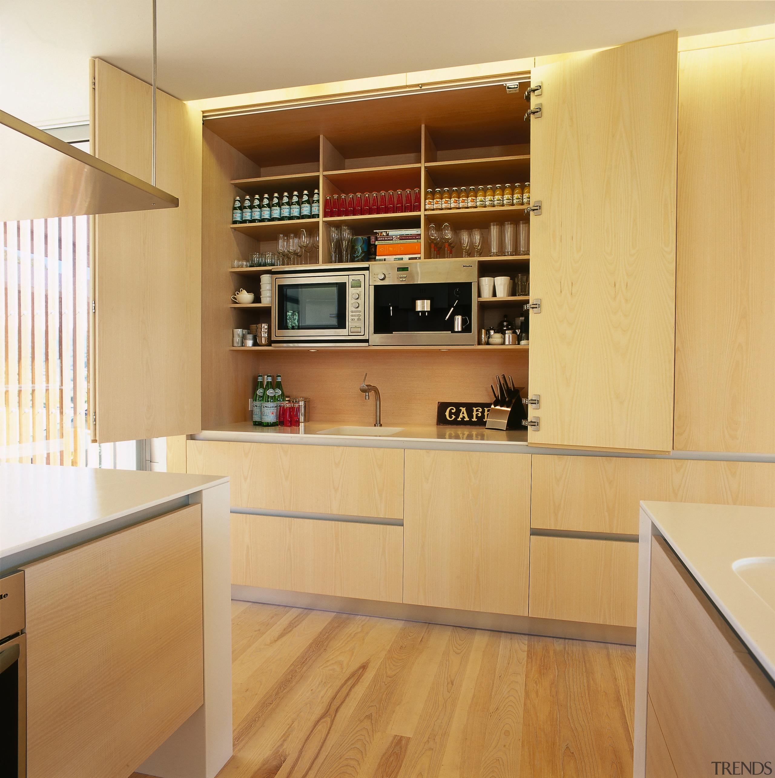 A view of a kitchen area, wooden flooring cabinetry, countertop, cuisine classique, floor, flooring, furniture, hardwood, interior design, kitchen, plywood, shelf, shelving, wood, wood flooring, orange