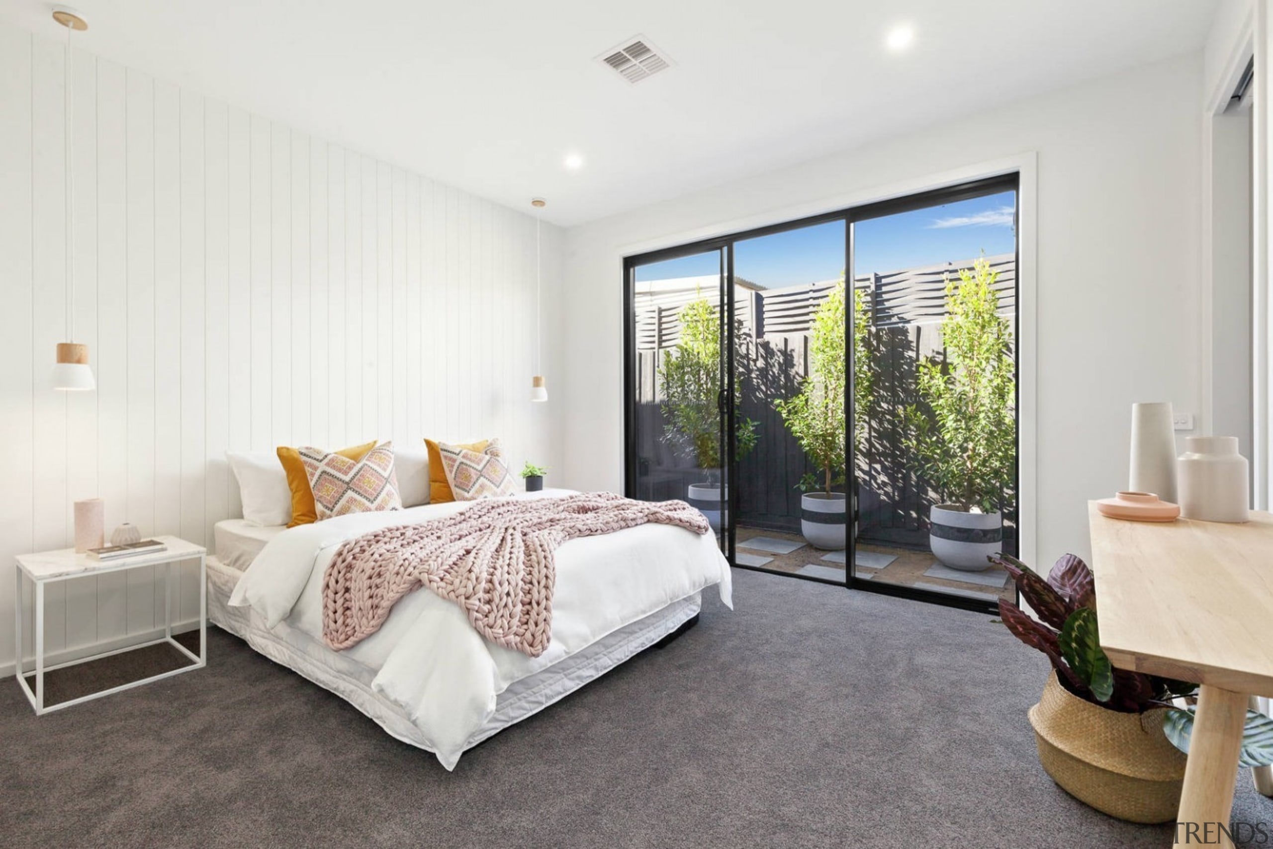 This ground floor bedroom faces out to a bed frame, bedroom, ceiling, estate, floor, home, interior design, property, real estate, room, window, white