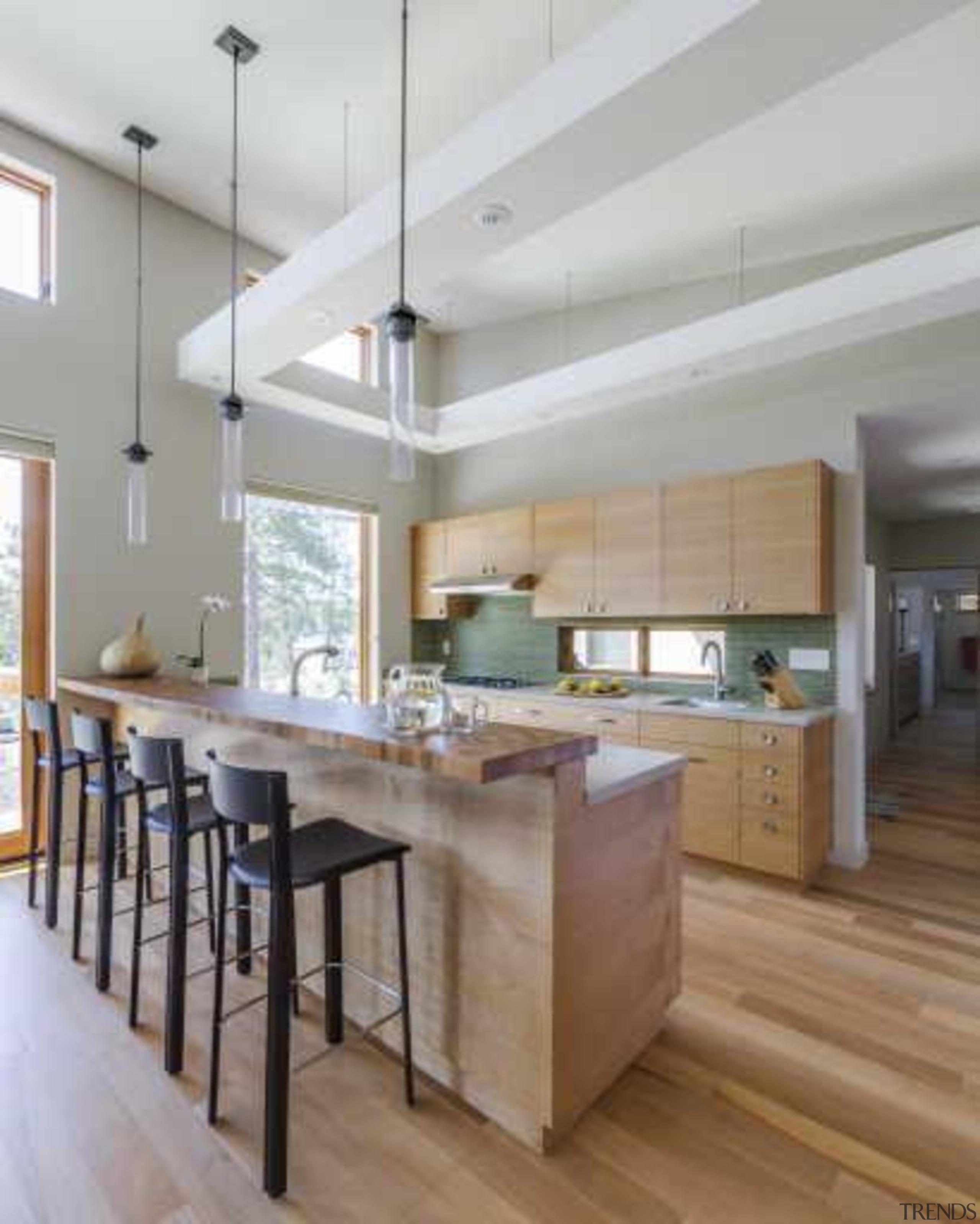 This home looks the part in a winter cabinetry, ceiling, countertop, cuisine classique, floor, flooring, hardwood, interior design, kitchen, laminate flooring, wood flooring, gray
