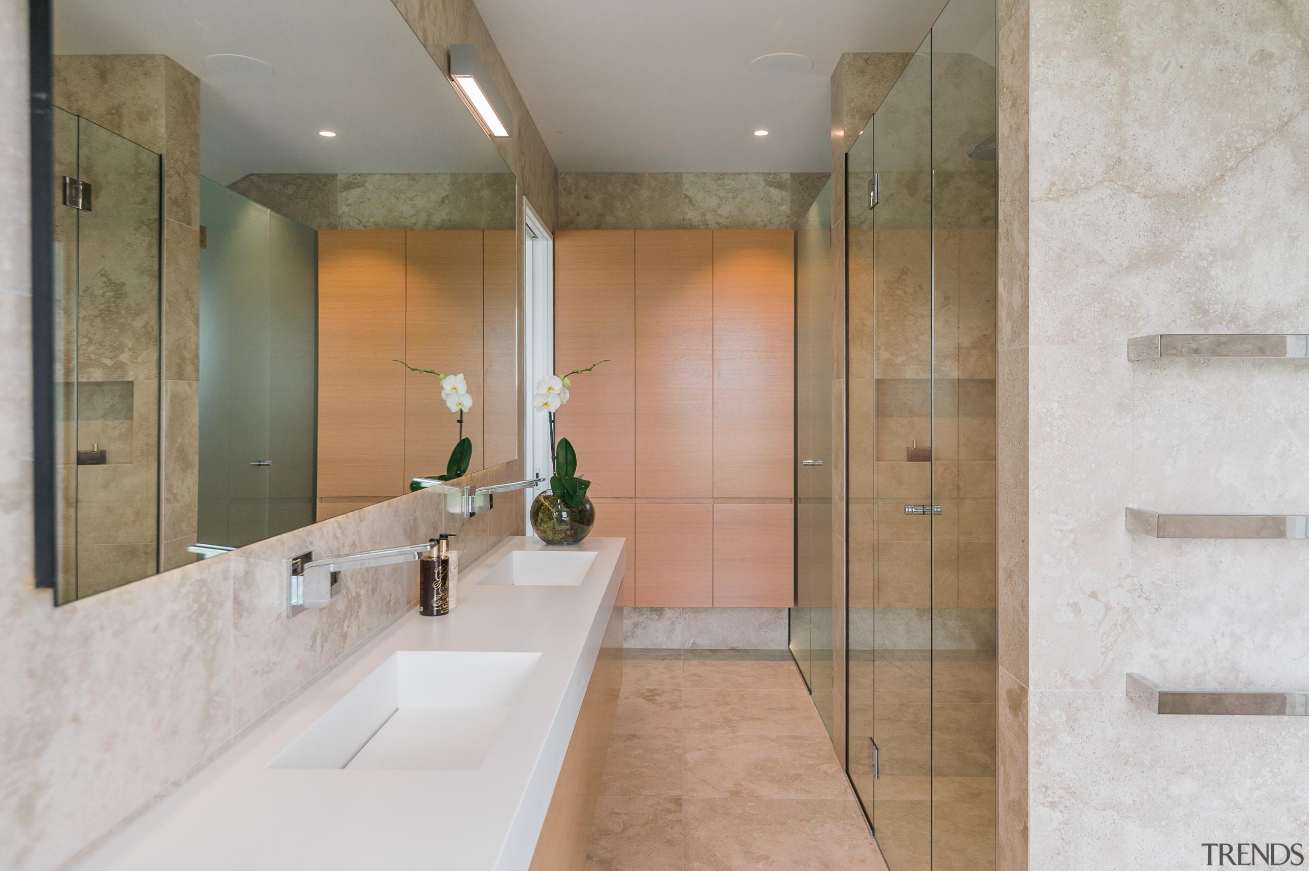 This long, narrow bathroom has the toilet at architecture, bathroom, floor, interior design, room, tile, gray