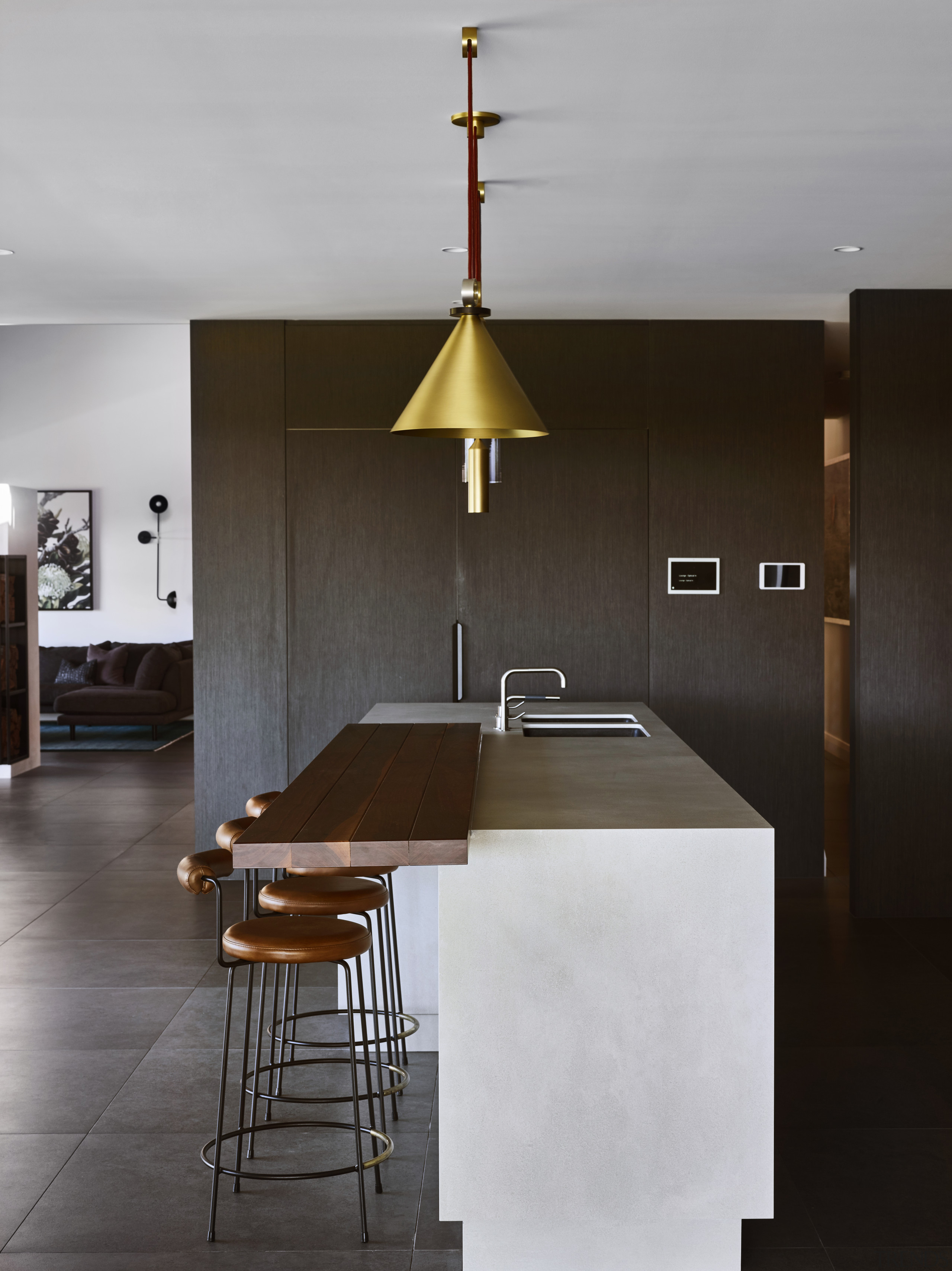 Wood stool tops and servery counter contrast the kitchen, design, Darren James, stoolls, servery, white porcelain