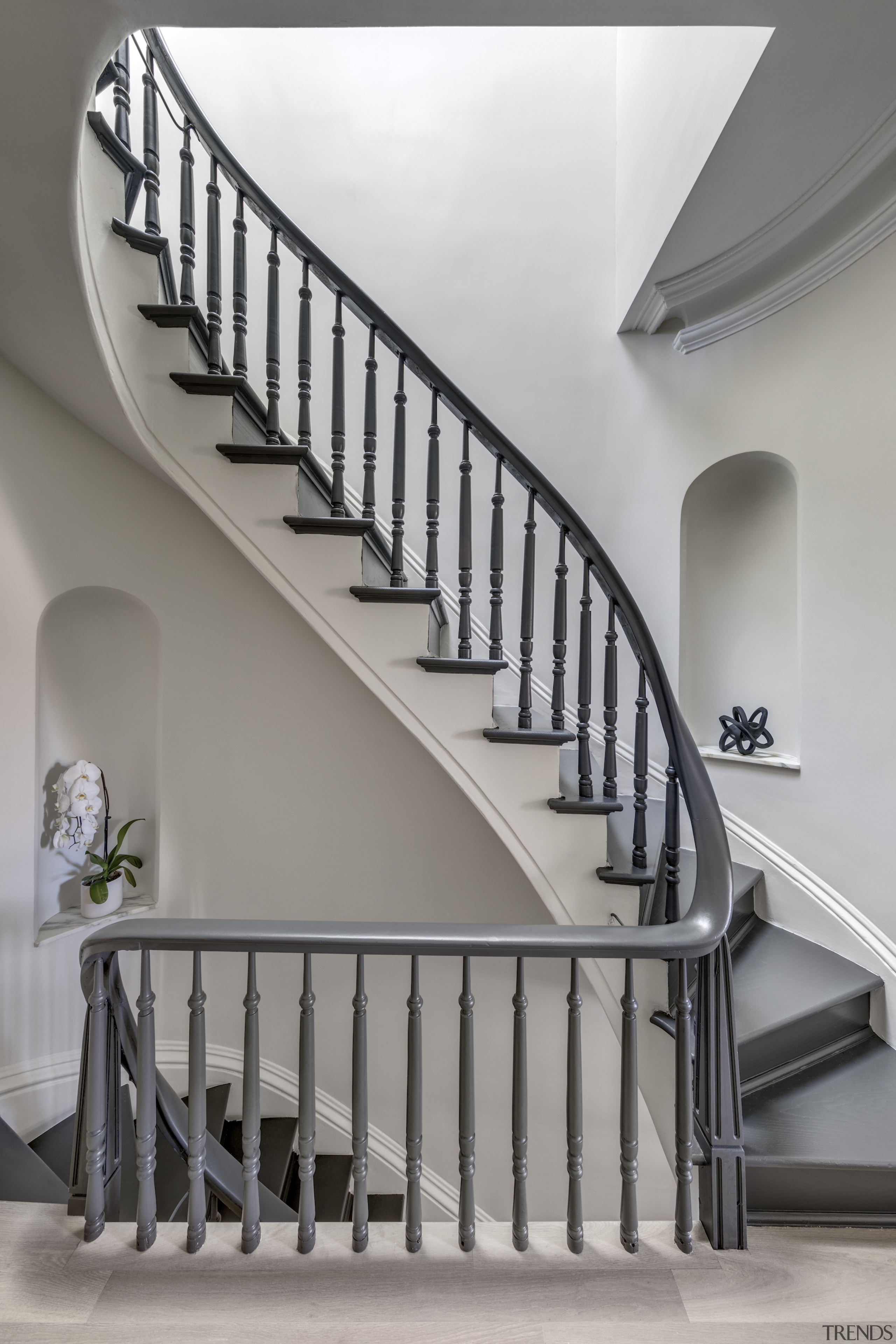 The existing wood stair and handrail were restored.