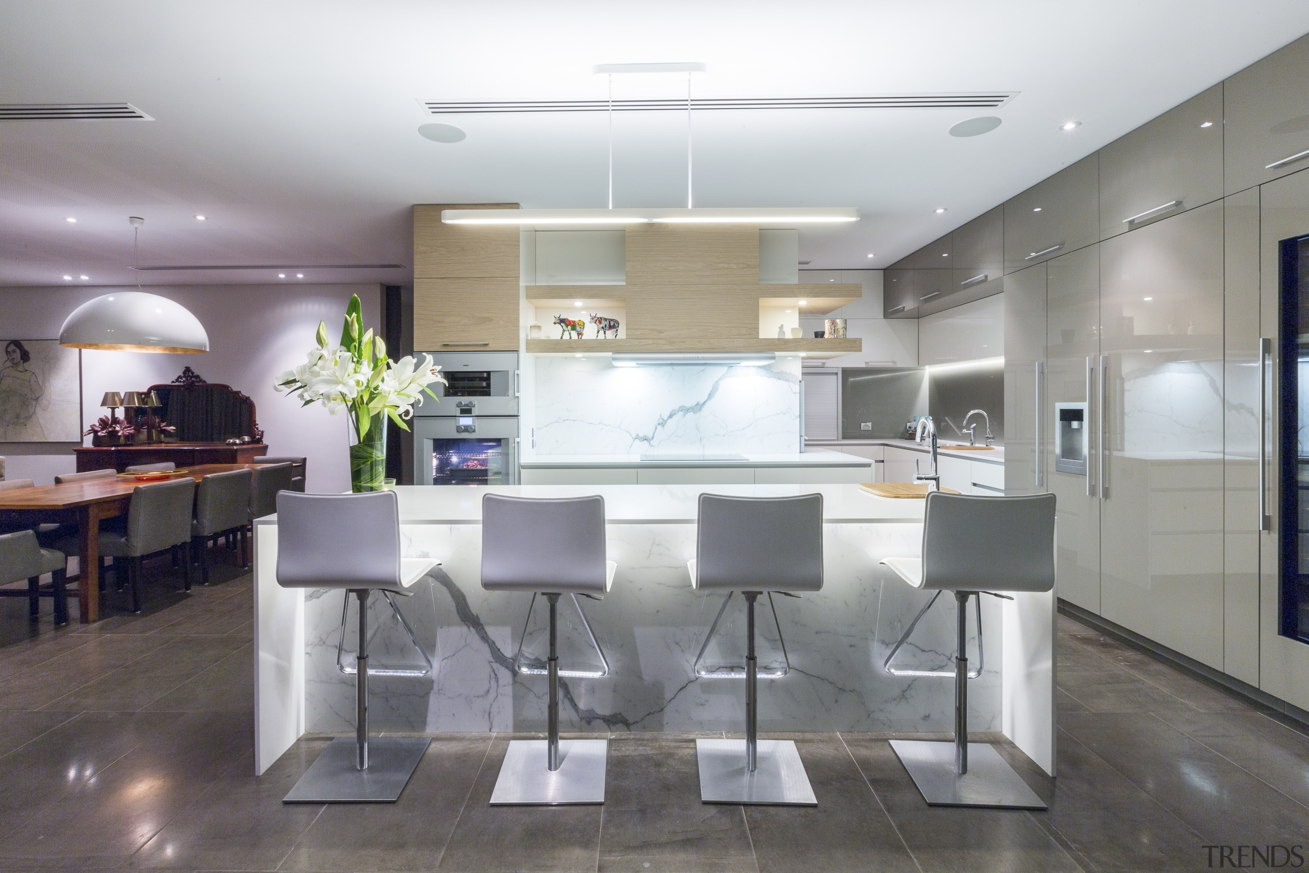 This contemporary kitchen in a renovated 1970s house ceiling, countertop, interior design, kitchen, real estate, table, gray, white