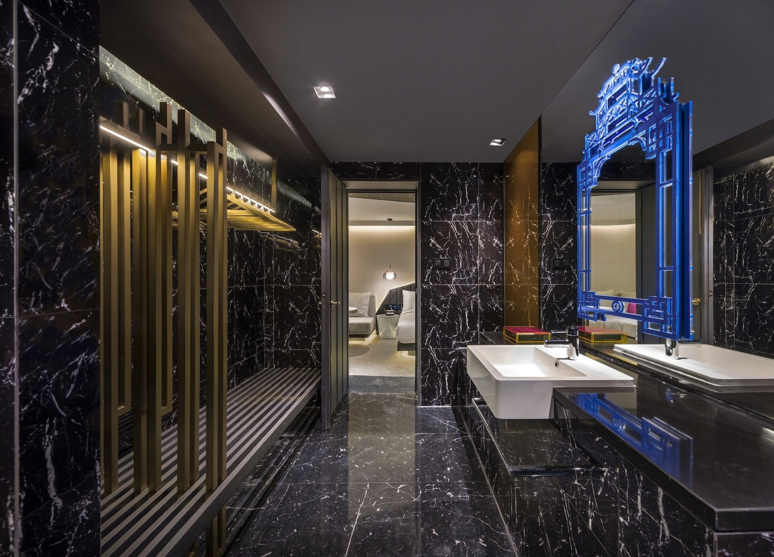 A blue frame mirror draws the eye - architecture, ceiling, home, interior design, lighting, lobby, real estate, black